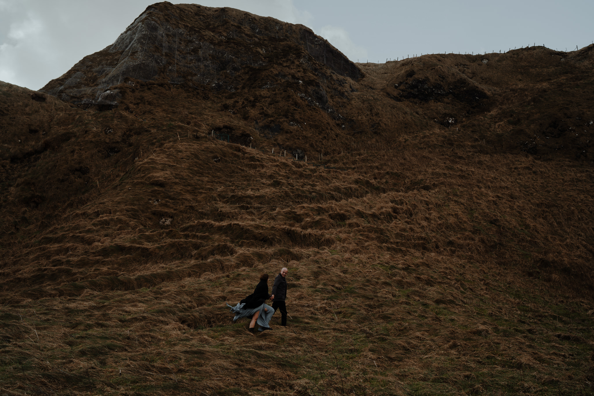 couple walking at kinbane castle