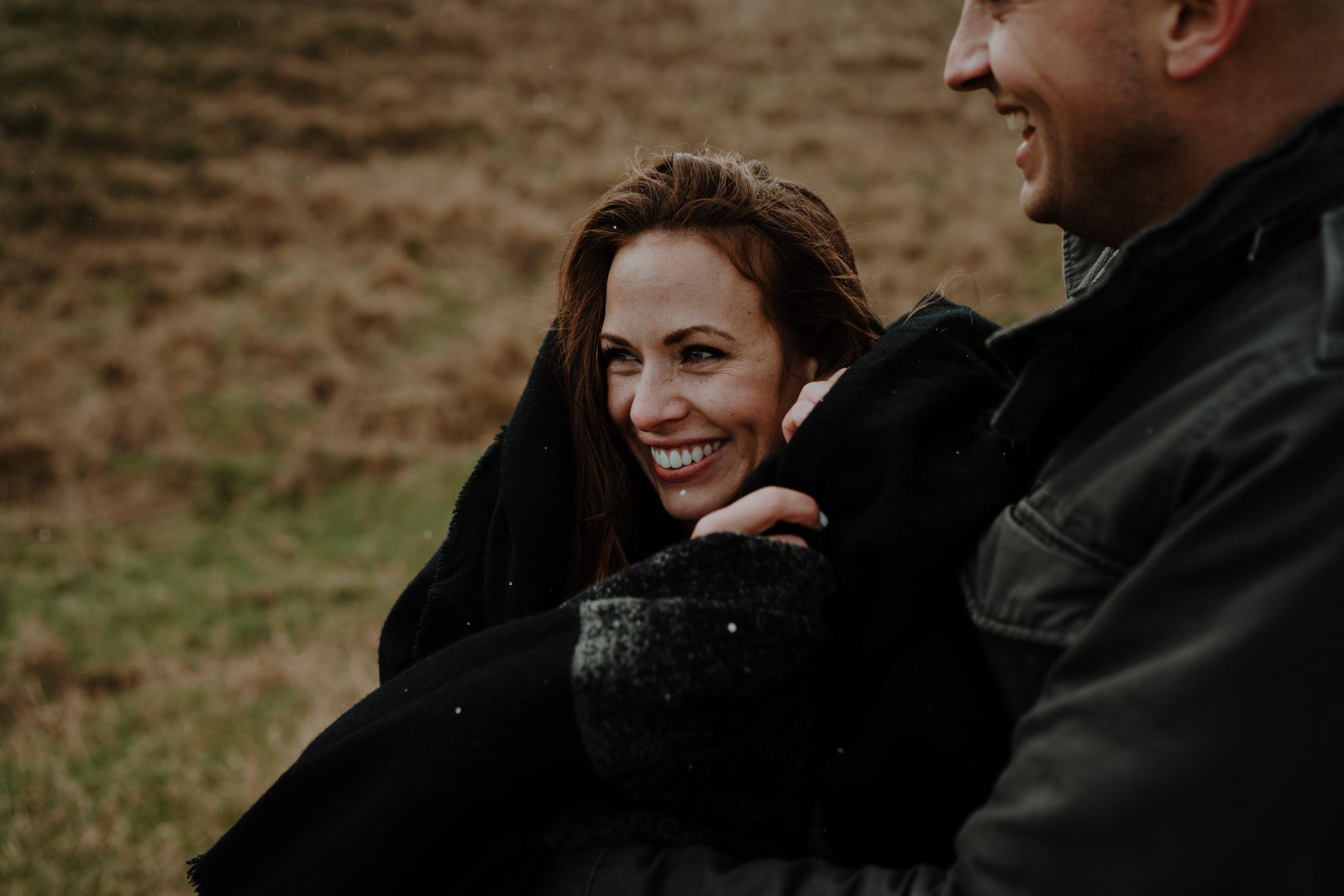 american couple visit ireland kinbane castle laughing