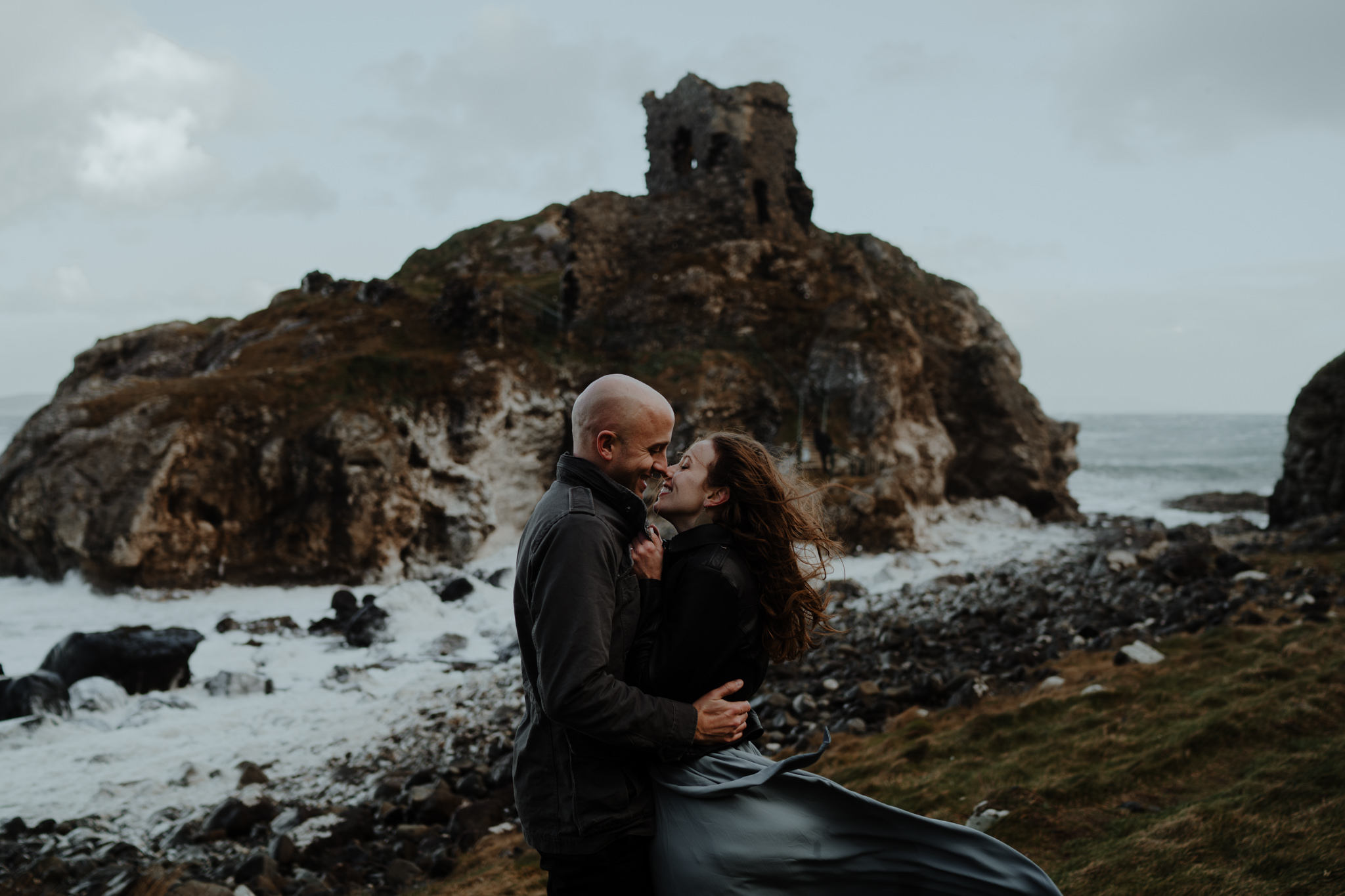 adventure travel ireland castle north coast kissing couple
