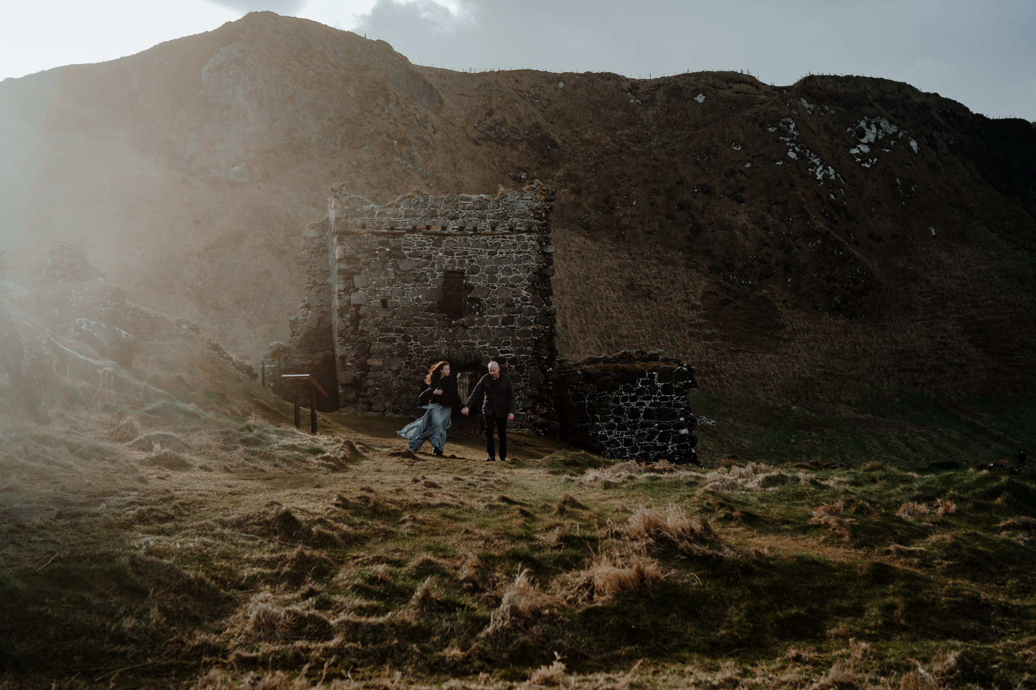 sunset at kinbane castle elopement photographers ireland wanderlust