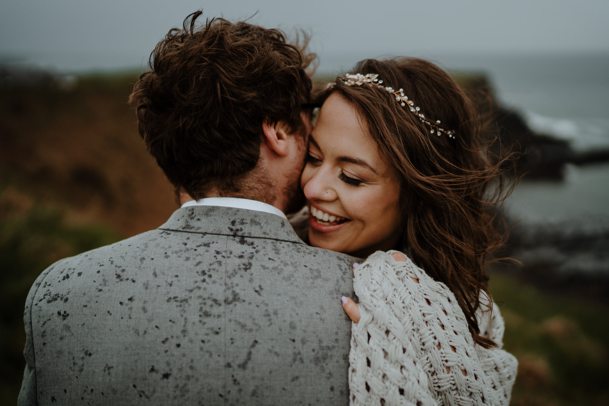 happy-couple-just-married-cliffs-dunluce-castle-elopement-photographers-Ireland
