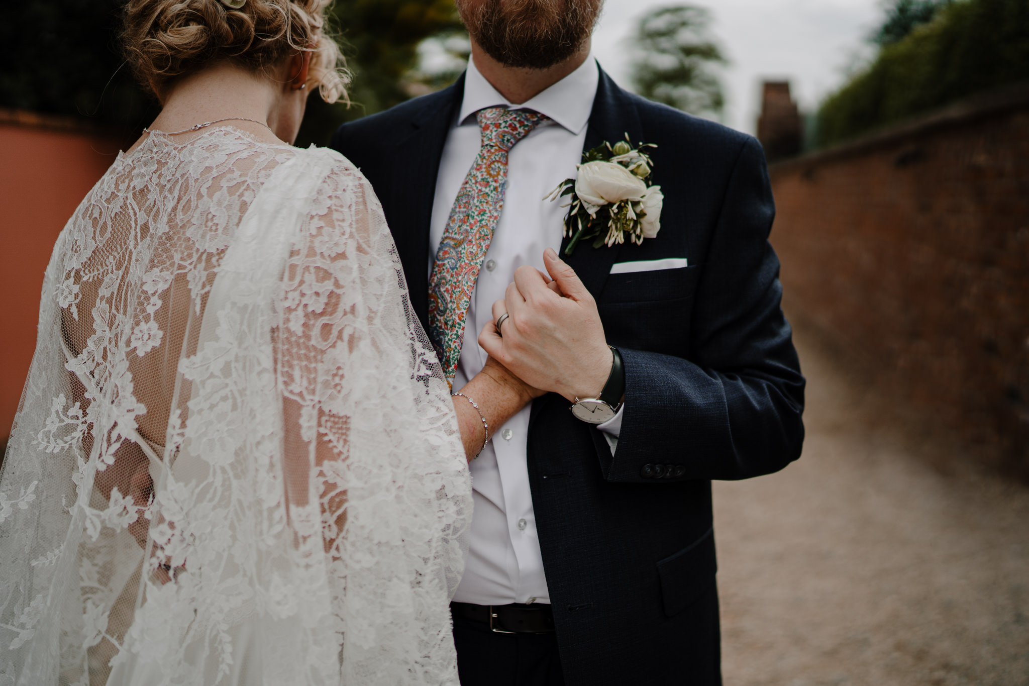 Tullyveery house wedding close up bride custome lace cape holding hands groom