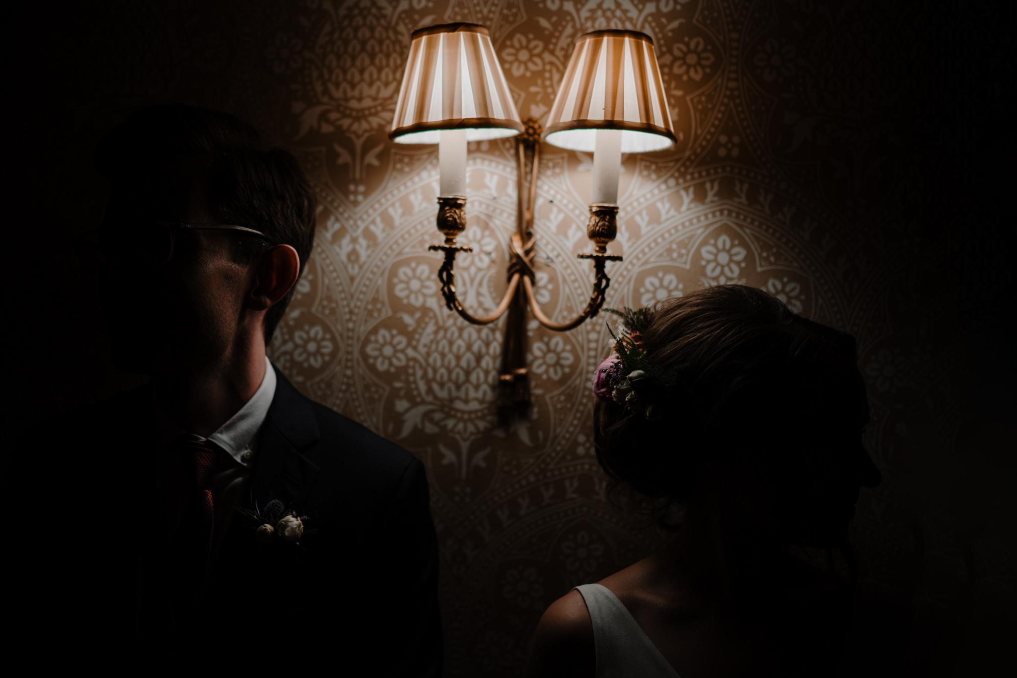 Intimate Wes Anderson style wedding crom castle bride groom lamplight