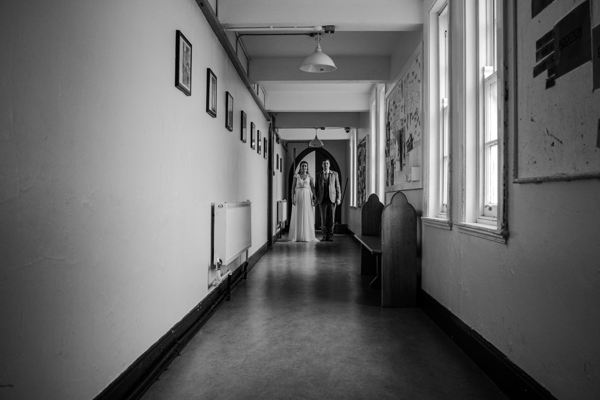 Alternative couple Dominican college wedding portstewart cinematic photos hallway