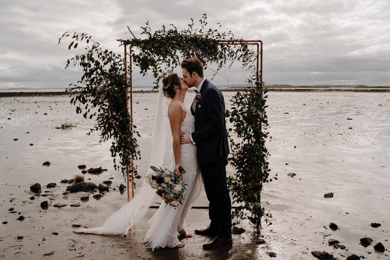 Orangetree House Wedding copper archway lough shore bride groom