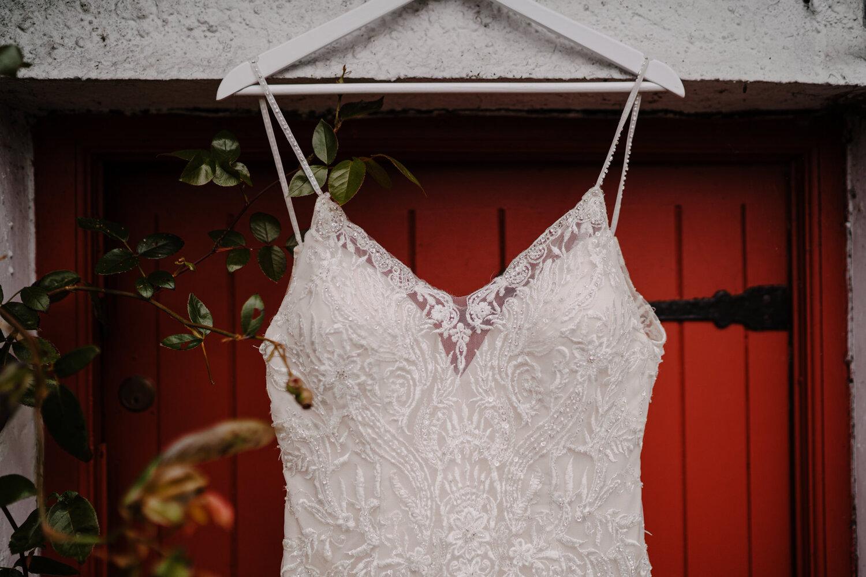 london bride wedding dress hanging red door