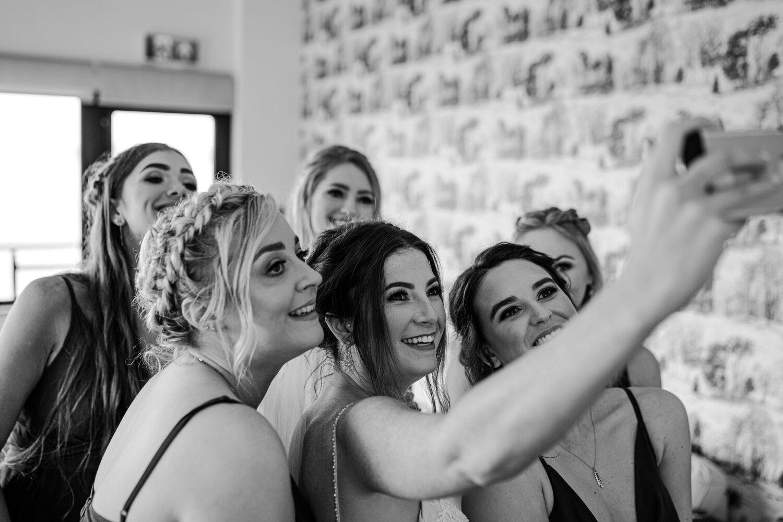 bride and bridesmaids selfie Orangetree House Wedding