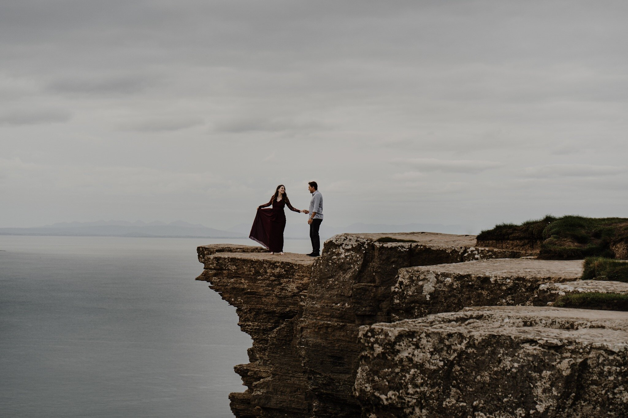 Cliffs-of-Moher-couple-cliff-edge-burgundy-dress-anniversary