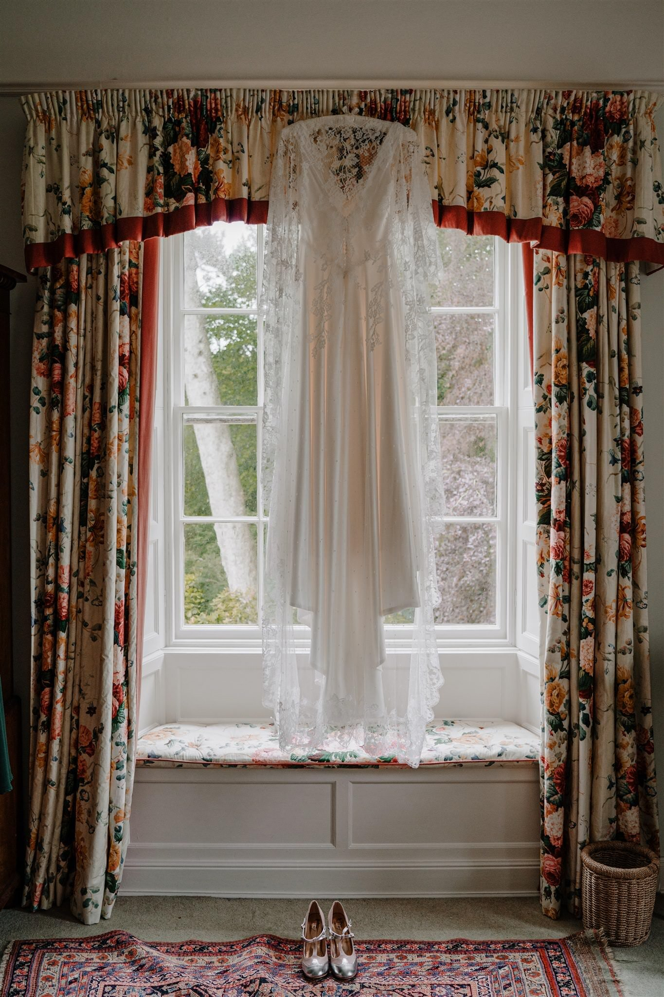 Custom Alison Jayne couture wedding dress hanging Tullyveery house window