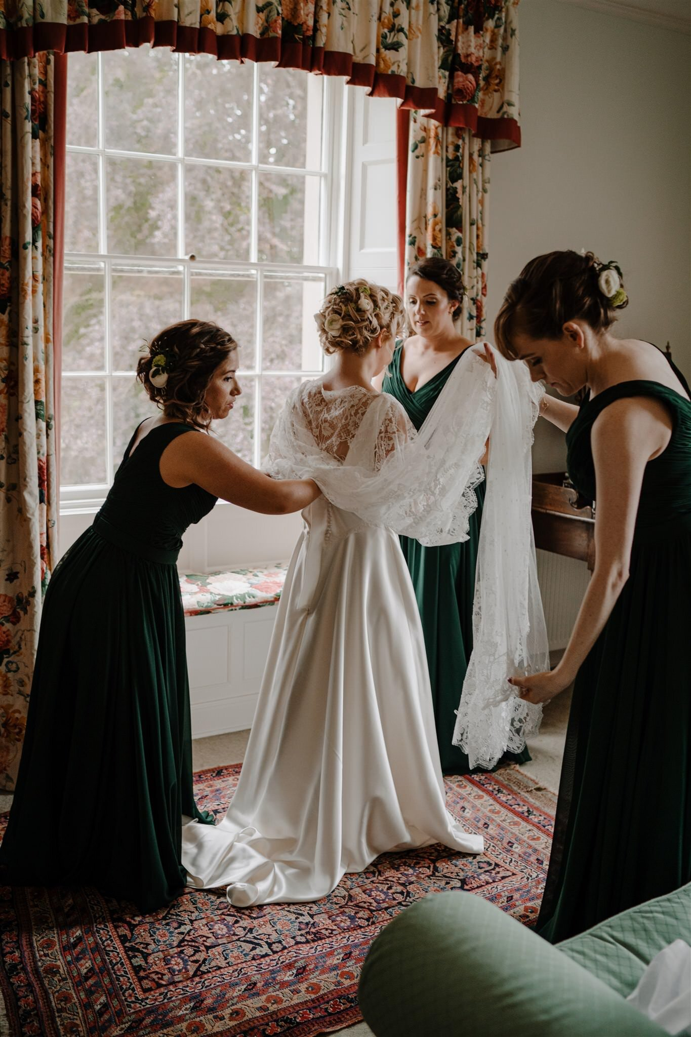 Bridesmaids help bride weddimg dress custom lace Alison Jayne couture