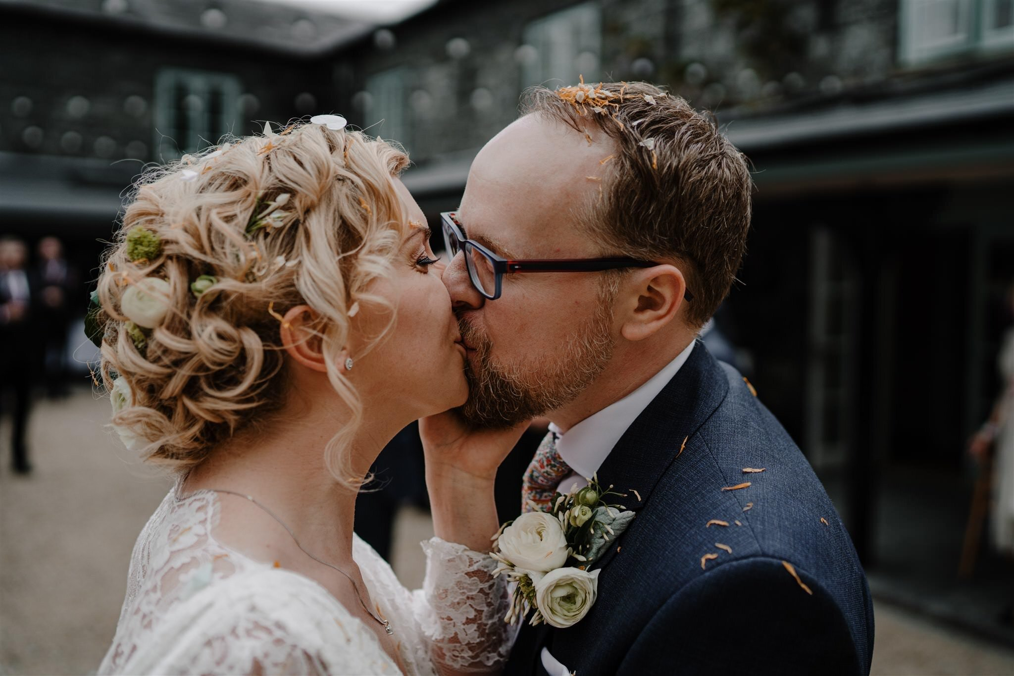 First kiss confetti bride groom outdoor summer wedding Tullyveery house