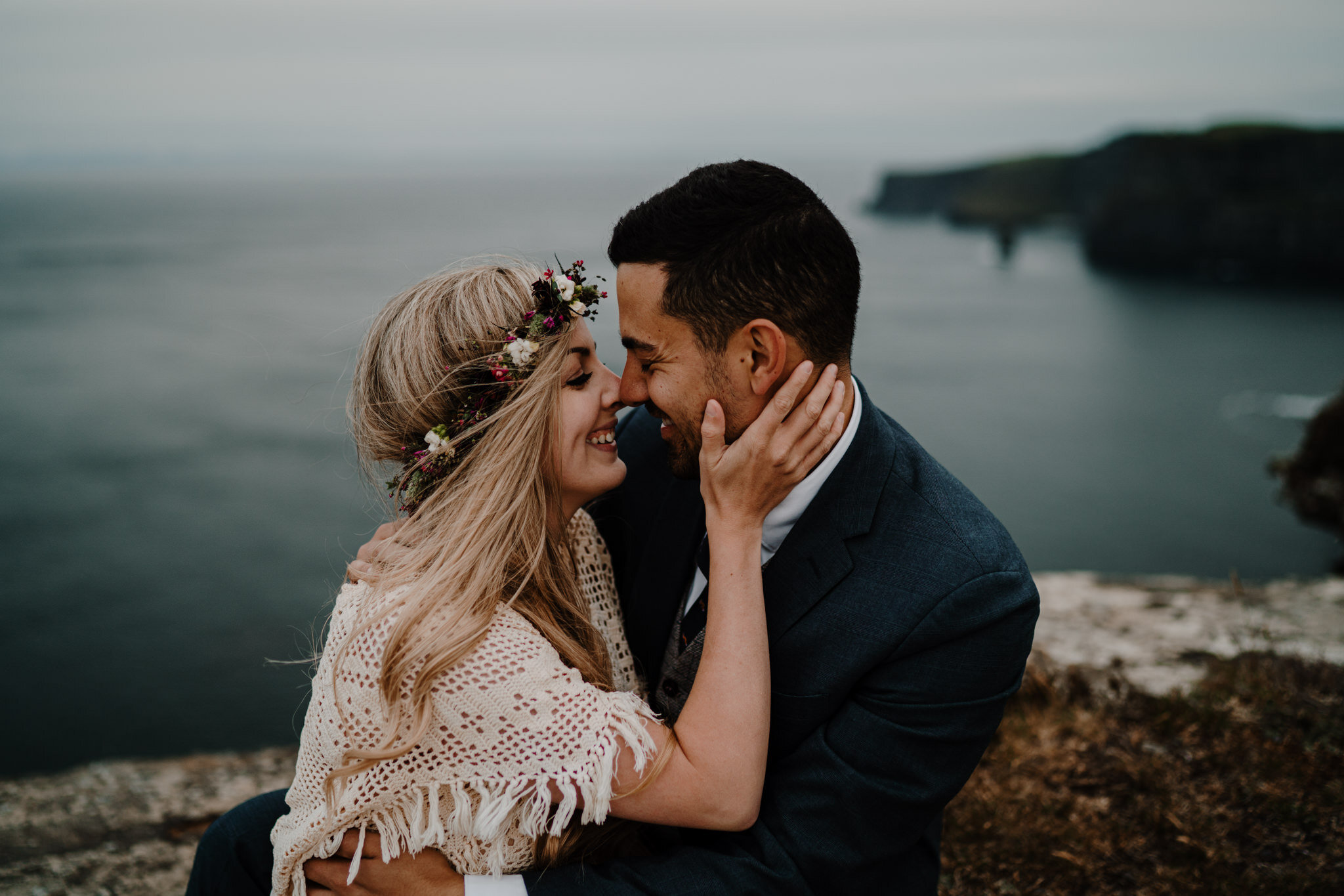 boho couple embrace and kiss cliffs edge anniversary session Cliffs of Moher ireland