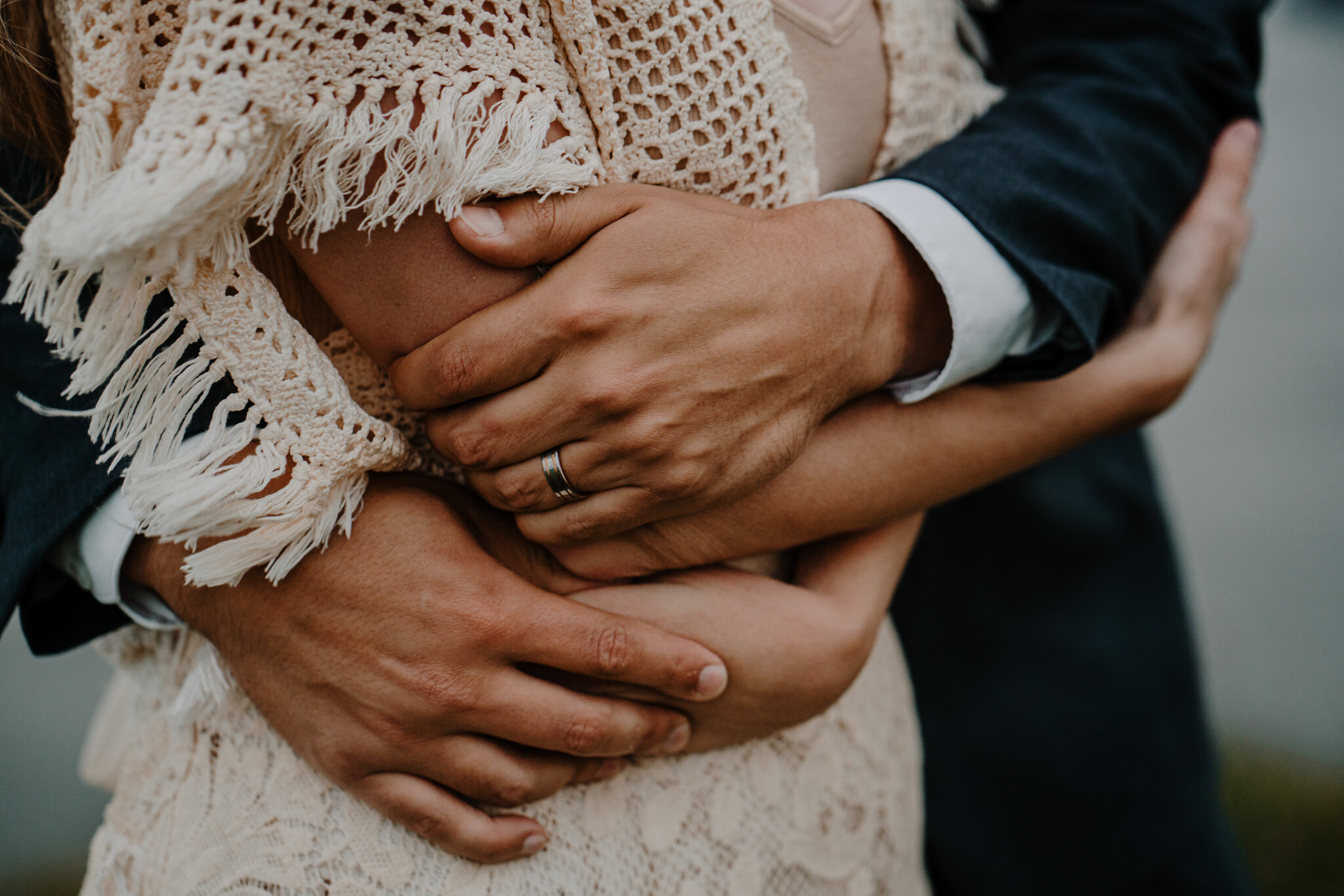 husband wife close up embrace crochet lace wedding dress custom made Cliffs of Moher ireland