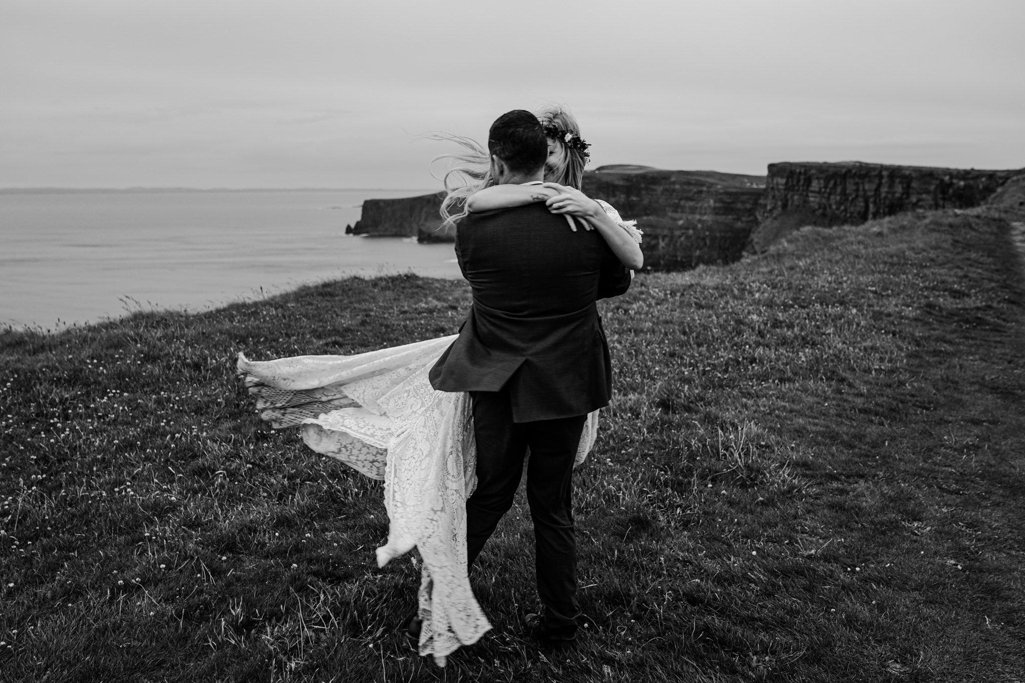 husband spins wife on cliffs edge Cliffs of Moher ireland