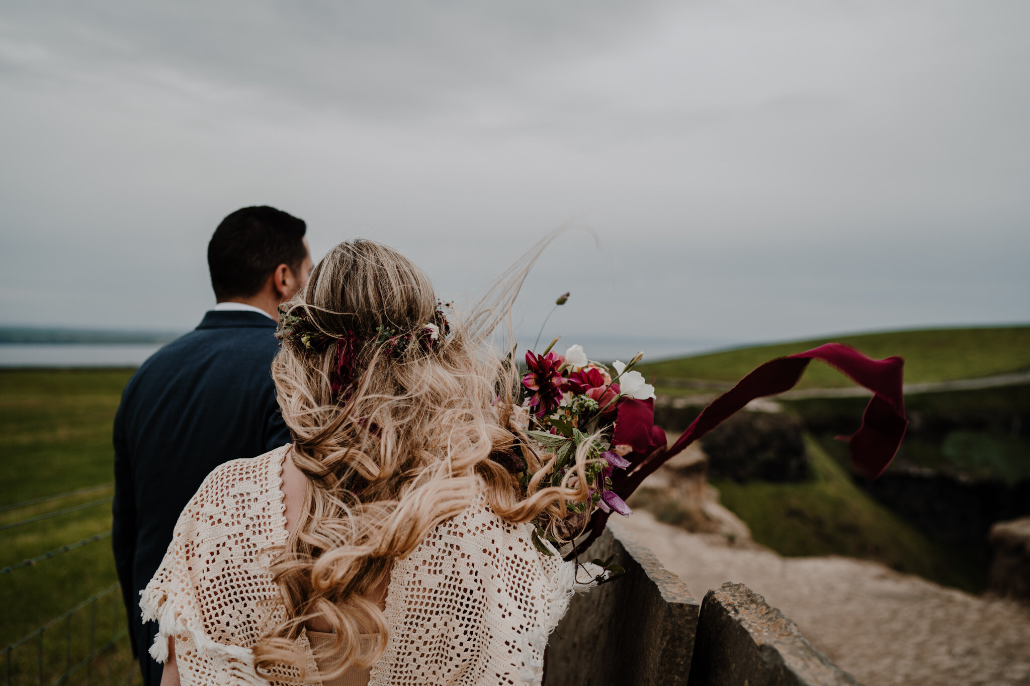 anthesis floral bouquet flows in wind at cliffs of moher adventure elopement
