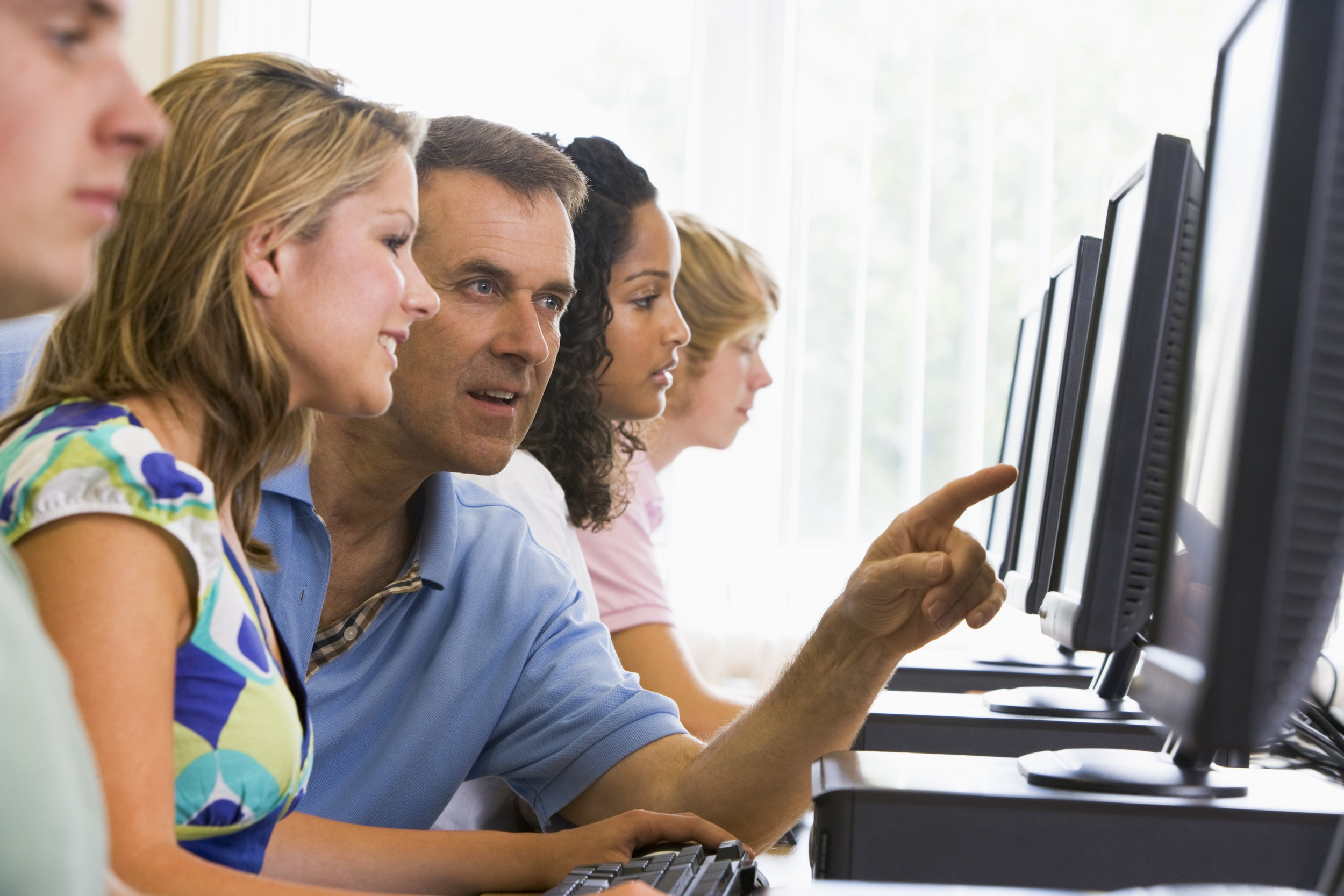 Computer teaching - purchased from shutterstock (large).jpg
