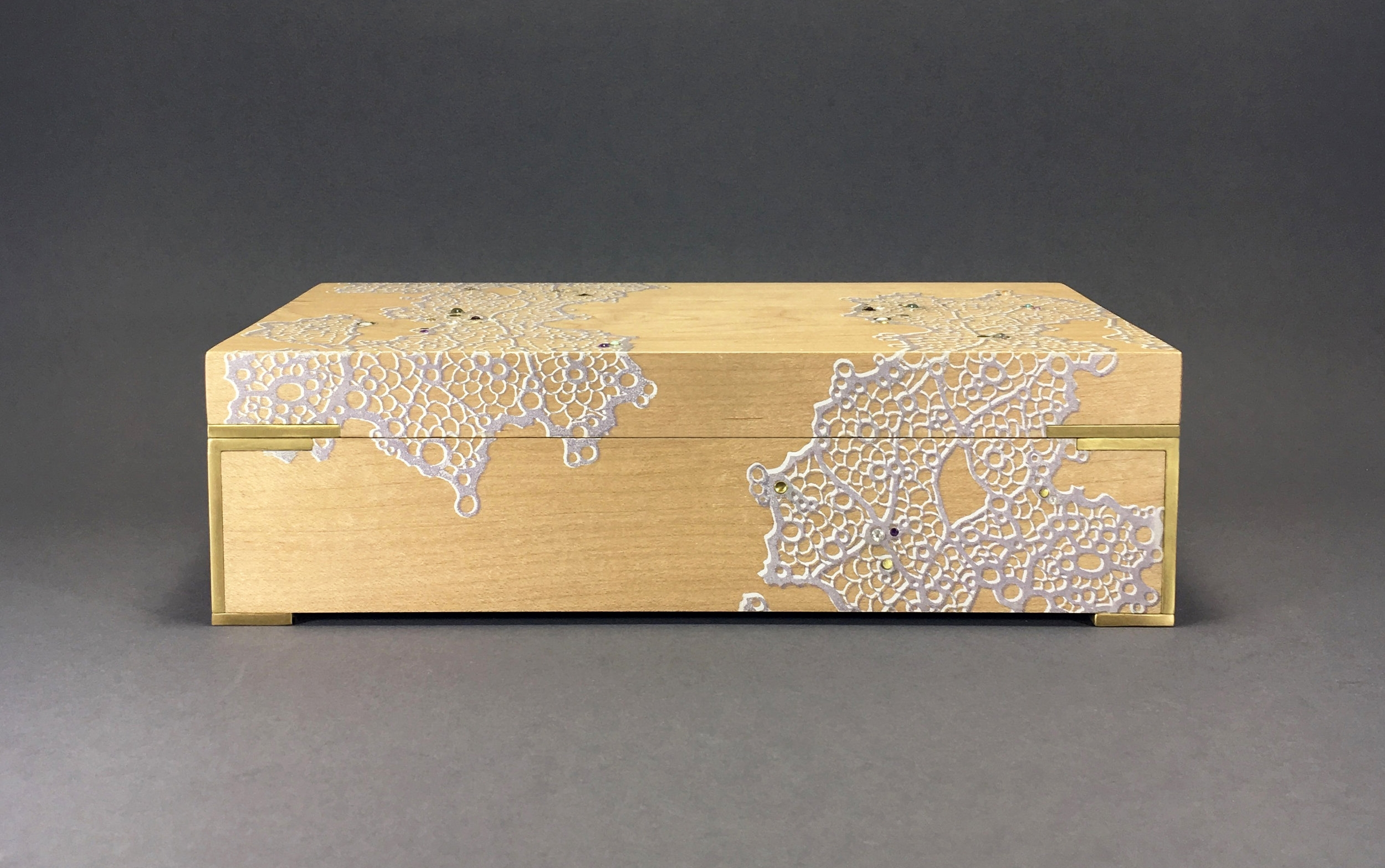 """lace  box, maple, 9"""" x 5"""" x 2.75"""", brass, amethyst, white topaz, opal, moonstone, and aquamarine gemstones, lined with navy suede, $450"""