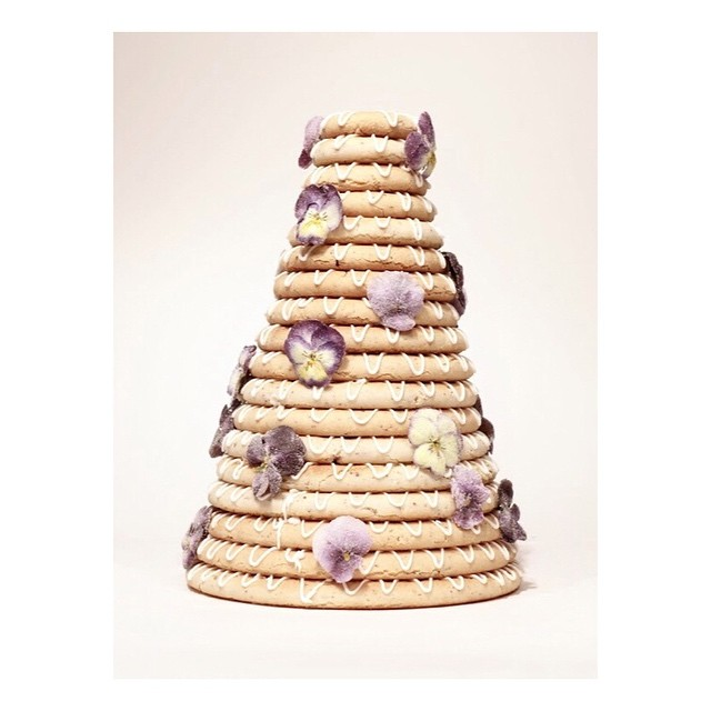 A full sized 18 ring stack, decorated with sugared pansies in yellows and lilac. Sugaring flowers takes a long time but the result is worth it! . . . . . #almondringcake #glutenfreecake #glutenfree #cakes #cakedecorating #edibleflowers #weddingcake #kransekake #scandinavianwedding