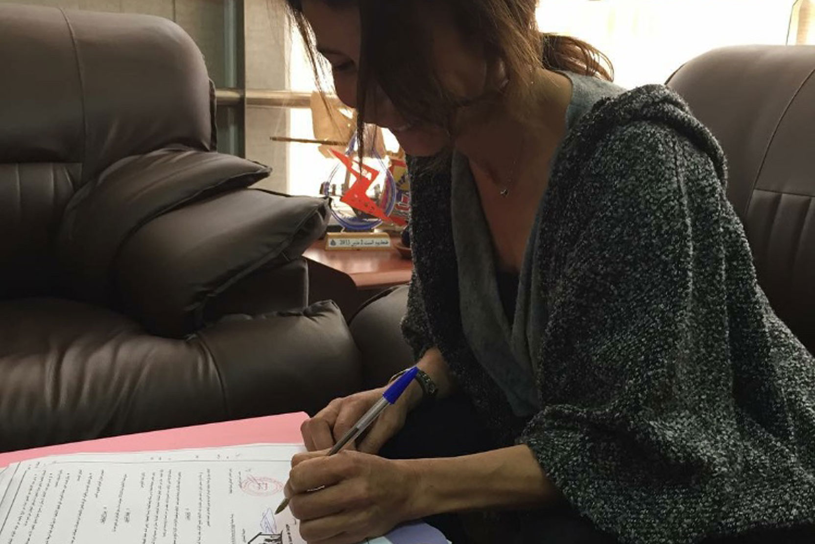 Sally signing an agreement with the Mayor of Tangier to protect our strays.