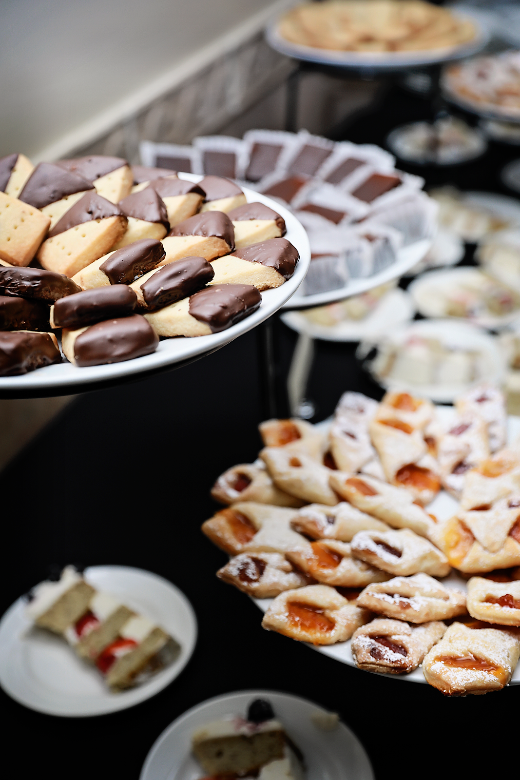 Chocolate dipped short bread cookies and kolacky cookies to reflect the grooms' English and Polish background. Photo by: Alicia's Photography
