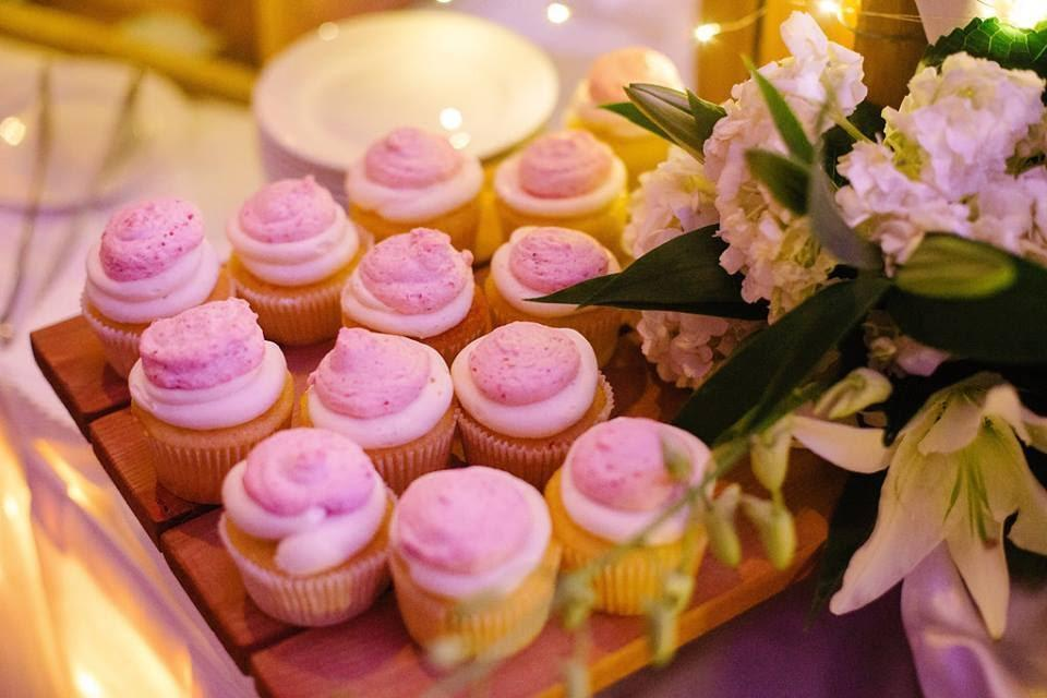 Lemon cupcakes with vanilla buttercream and raspberry mousse
