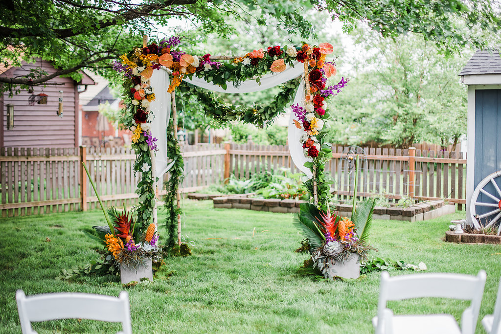 Bold Color Floral Wedding Arch Intimate Backyard Chicago Wedding Ella Farrell Weddings