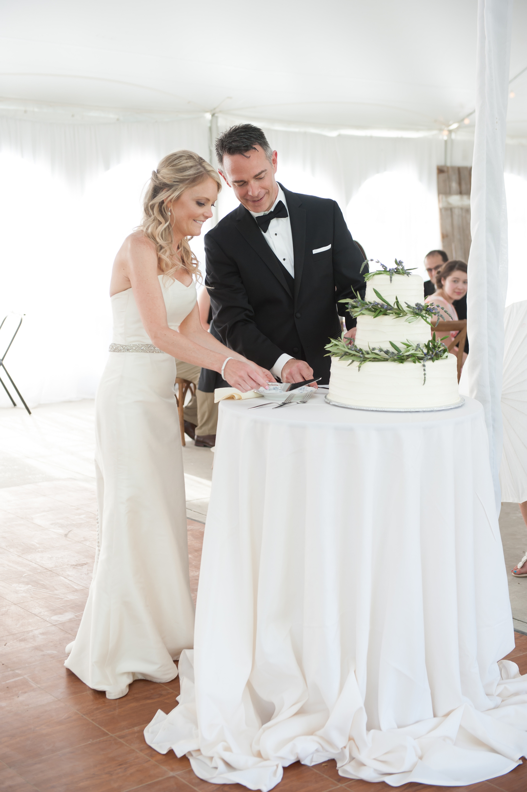 Bride and Groom Cutting the Cake Lavender Cake Chicago Farm Wedding Elite Photo