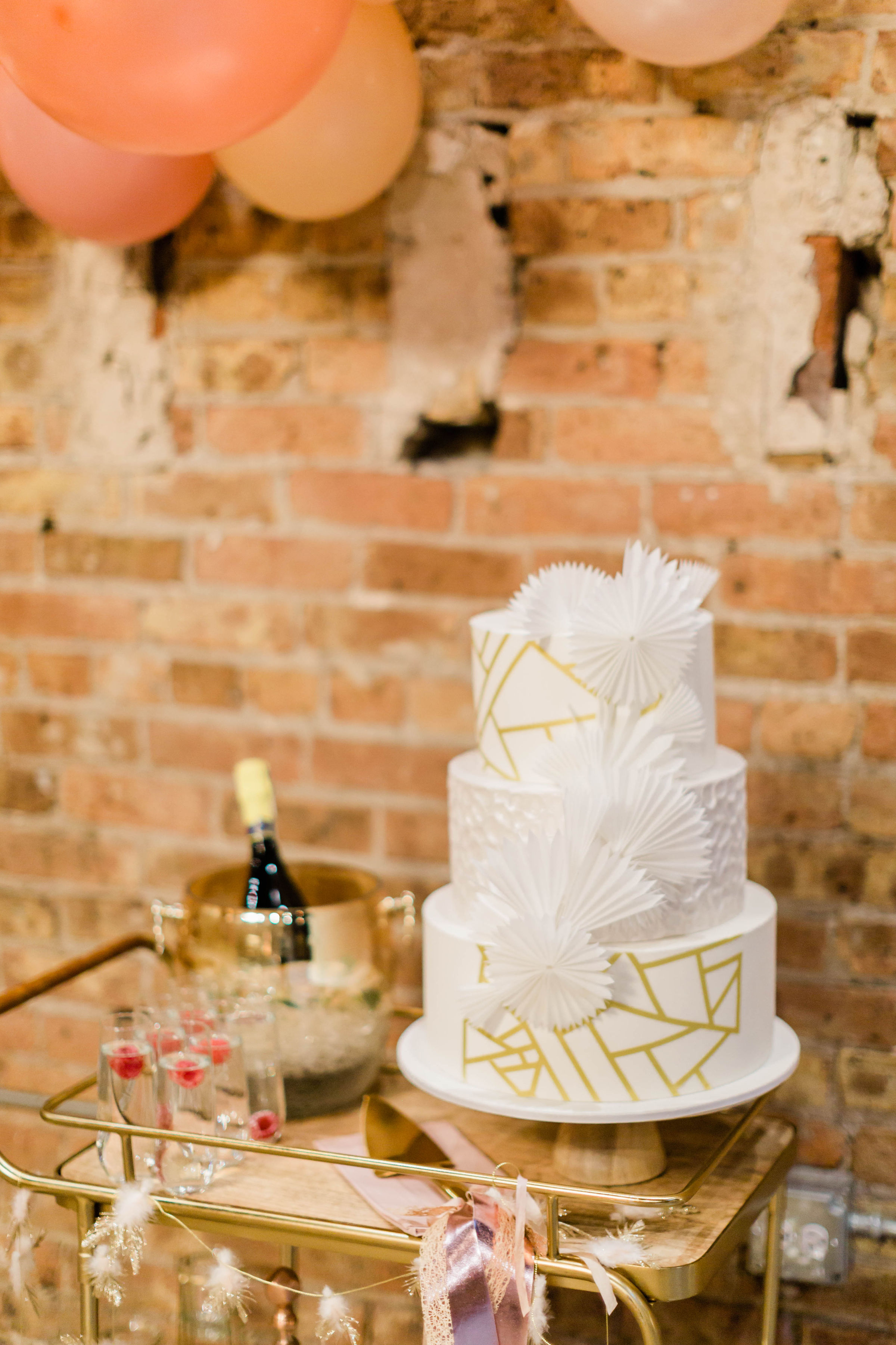 White and Gold Wedding Cake Photography by Lauryn