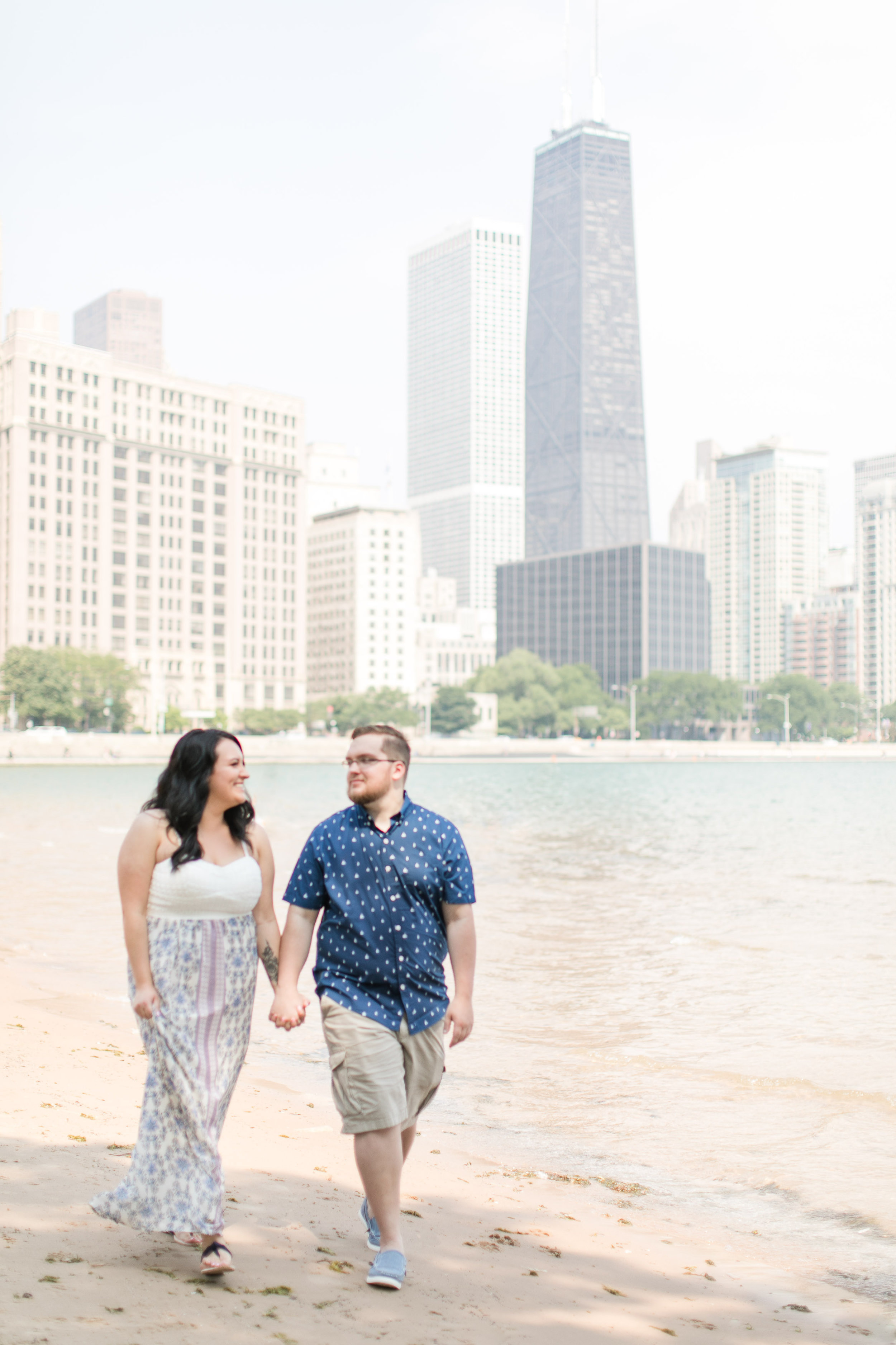 Summer downtown Chicago engagement session captured by Megan Goggins Photography. Find more inspiration at CHItheeWED.com!
