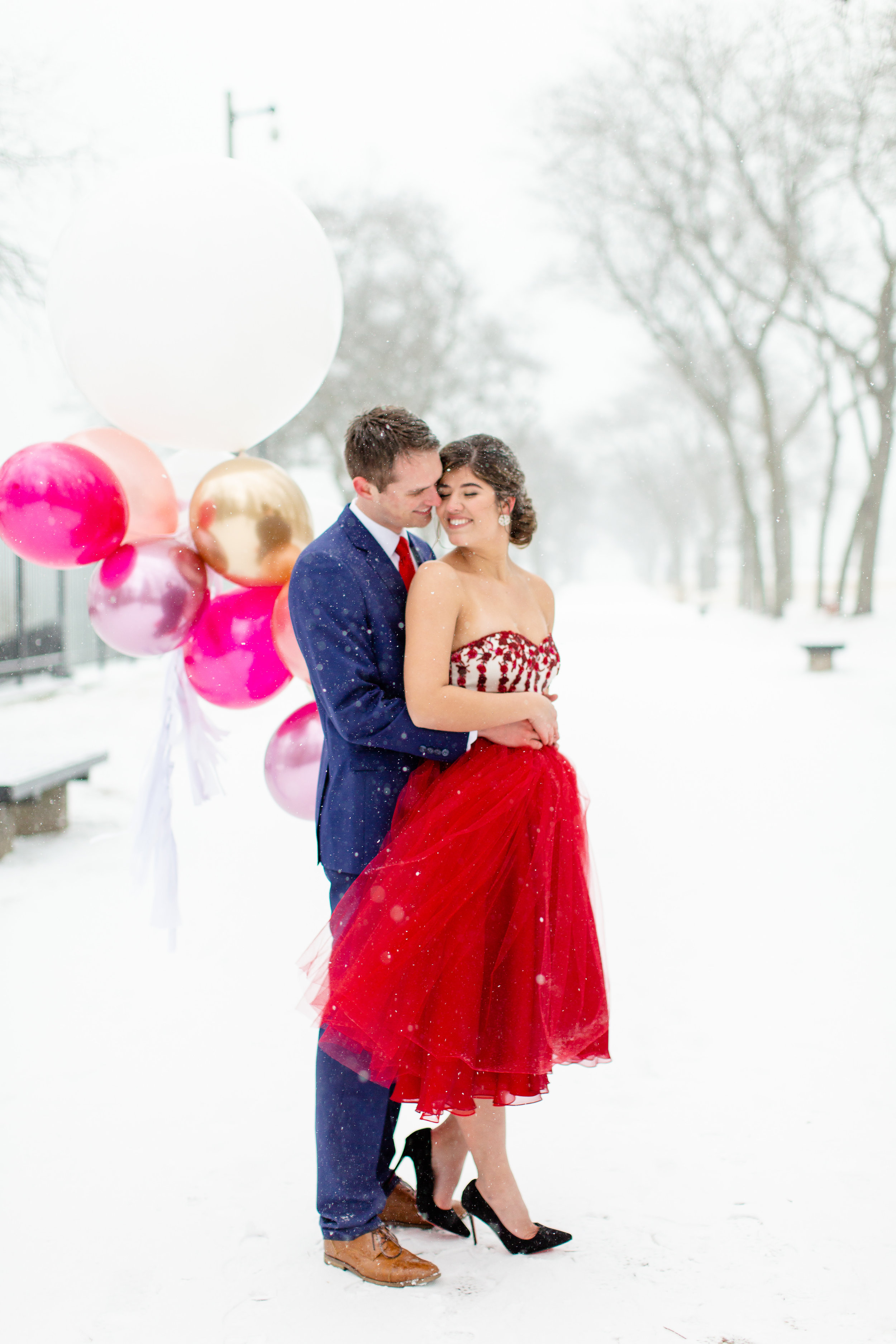 Snowy engagement photo styled shoot in downtown Chicago captured by Amy Mulder Photography. See more engagement photo ideas at CHItheeWED.com!