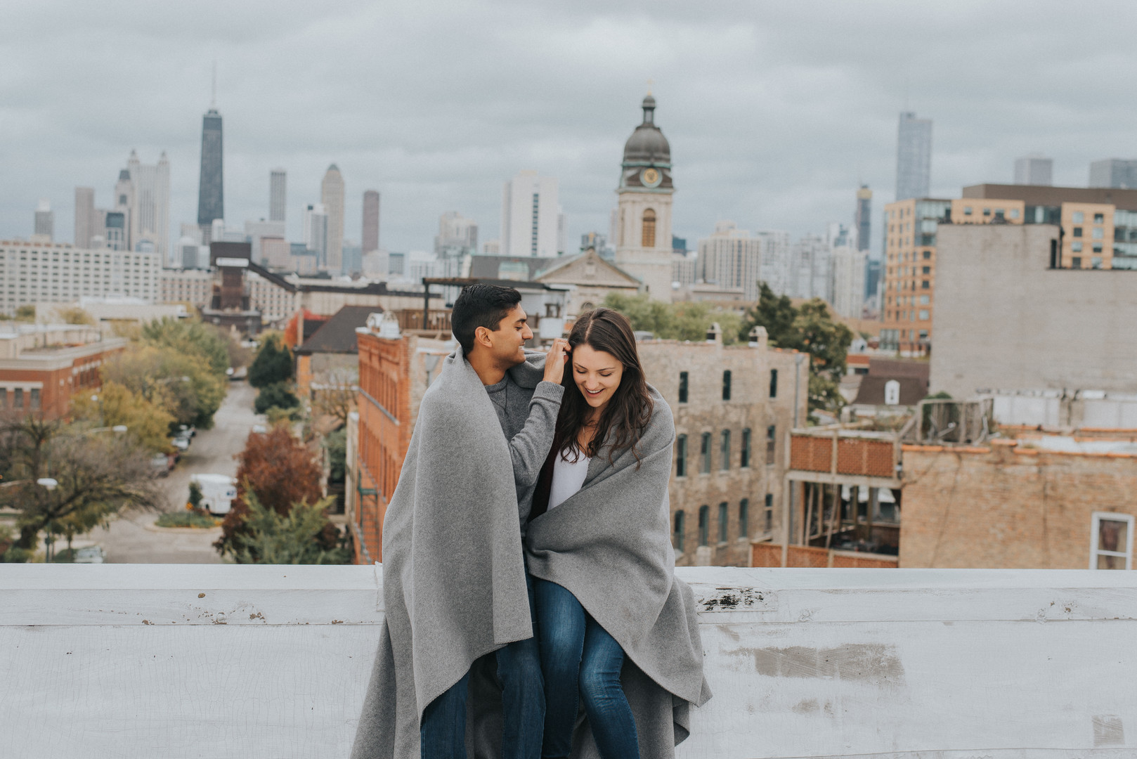 Chicago rooftop and Millennium Park engagement session captured by Kendra Lynece Photography. See more engagement photo ideas at CHItheeWED.com!