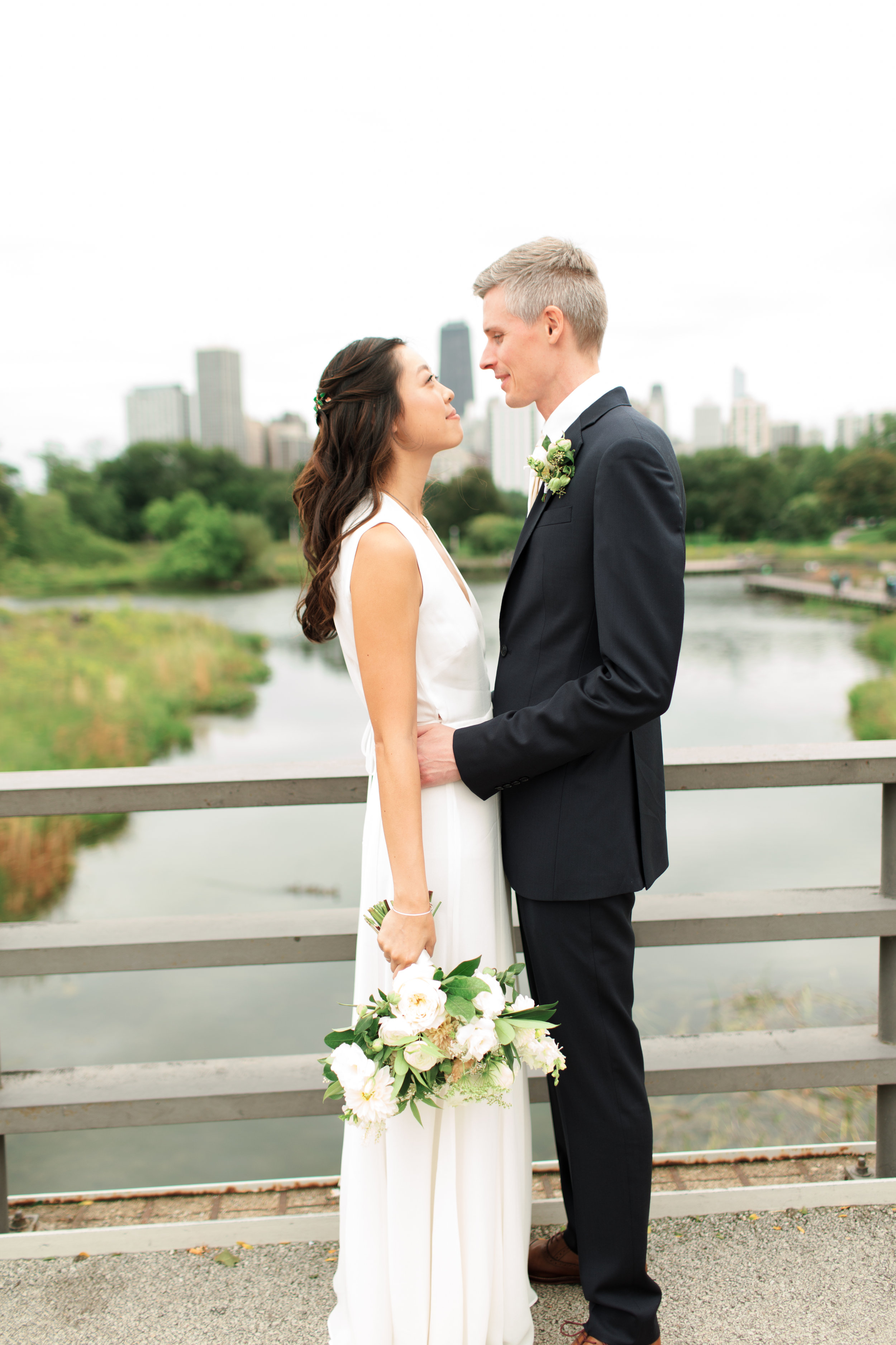 Intimate Chicago rooftop wedding at Homestead on the Roof captured by Geneva Boyett Photography. See more wedding ideas at CHItheeWED.com!