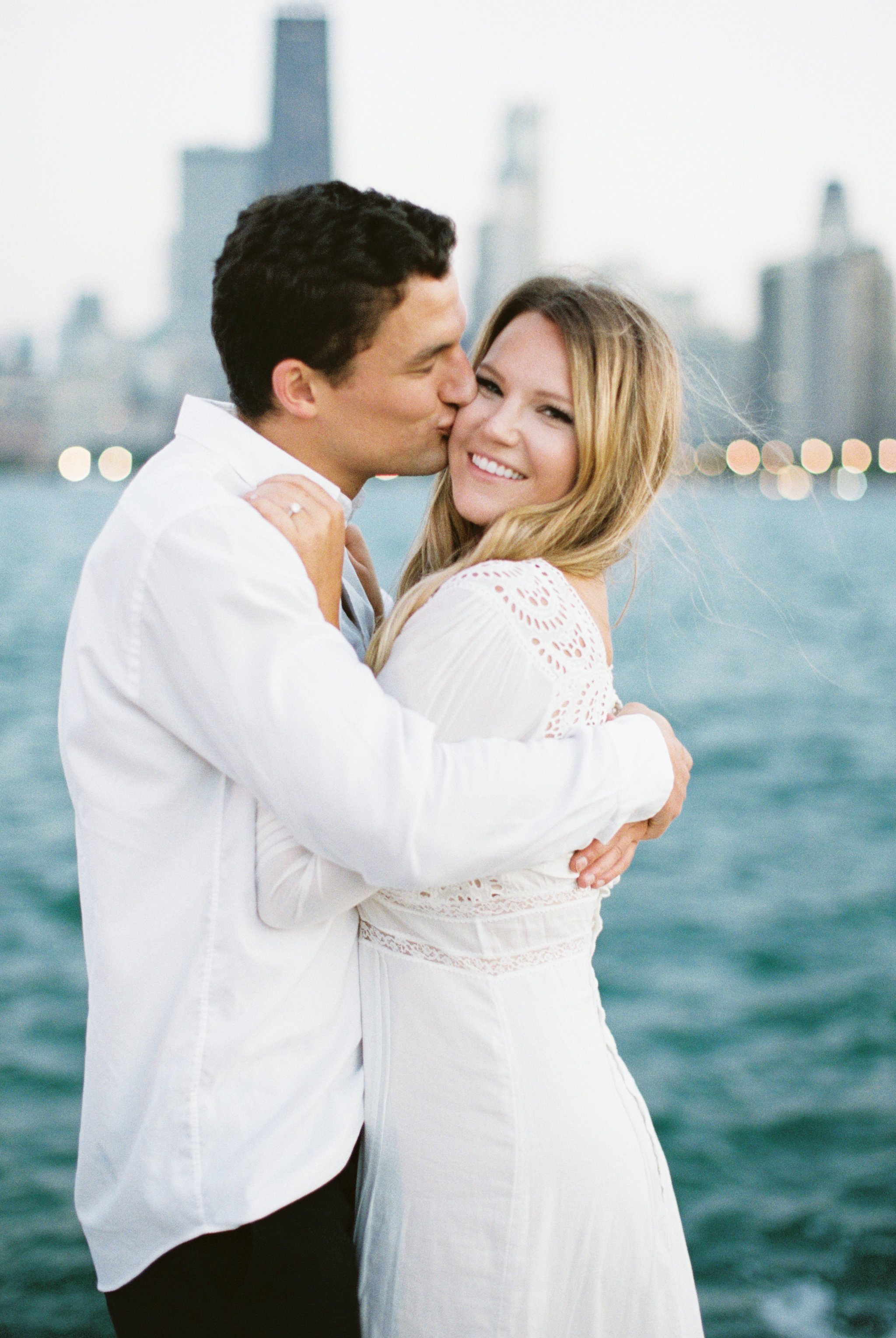 Romantic North Avenue Beach Chicago engagement session captured by Kendra Denault Photography. See more engagement photo ideas on CHItheeWED.com!
