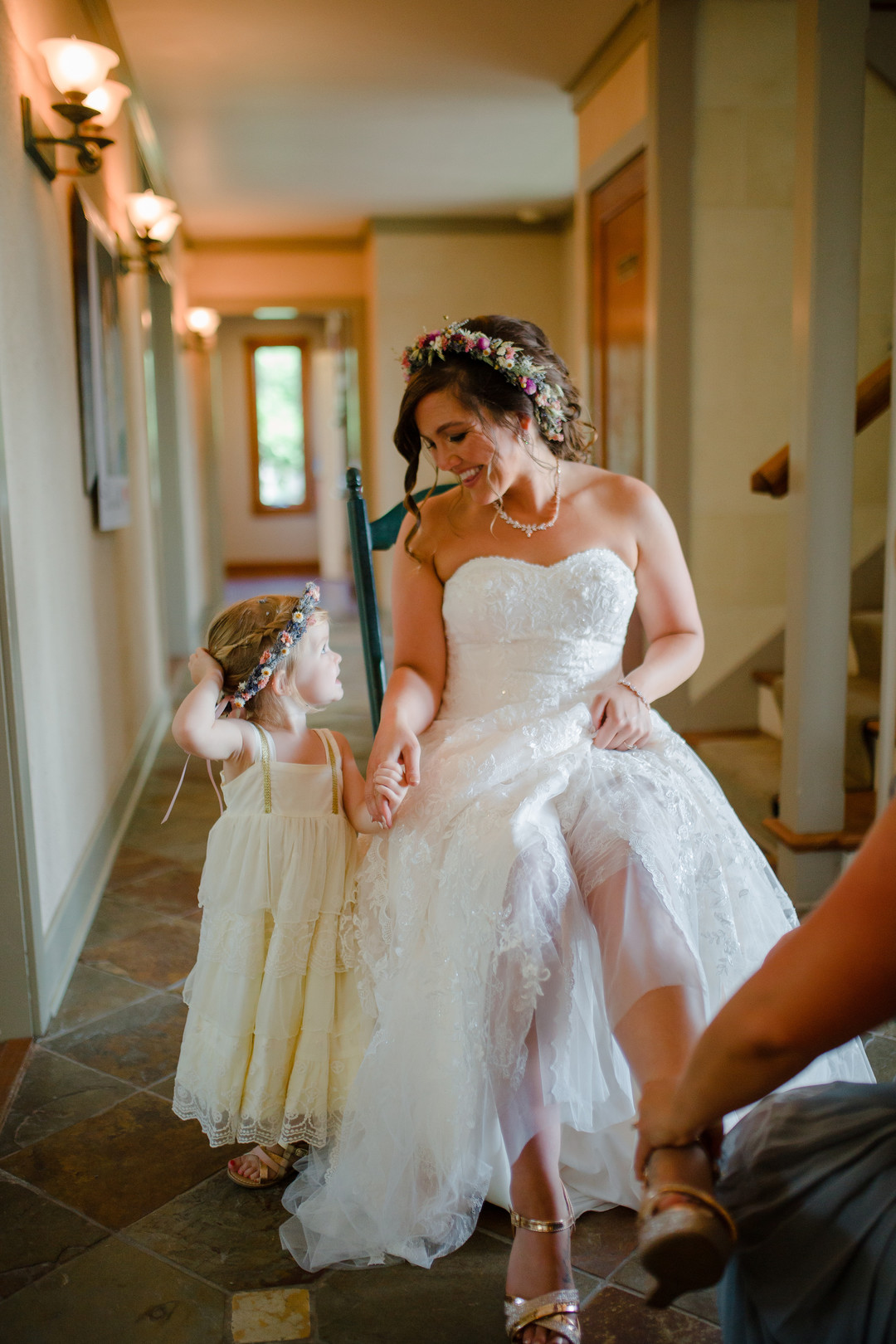 Bride and flower girl: Rustic country wedding in Minooka, IL captured by Katie Brsan Photography. Visit CHItheeWED.com for more wedding inspiration!