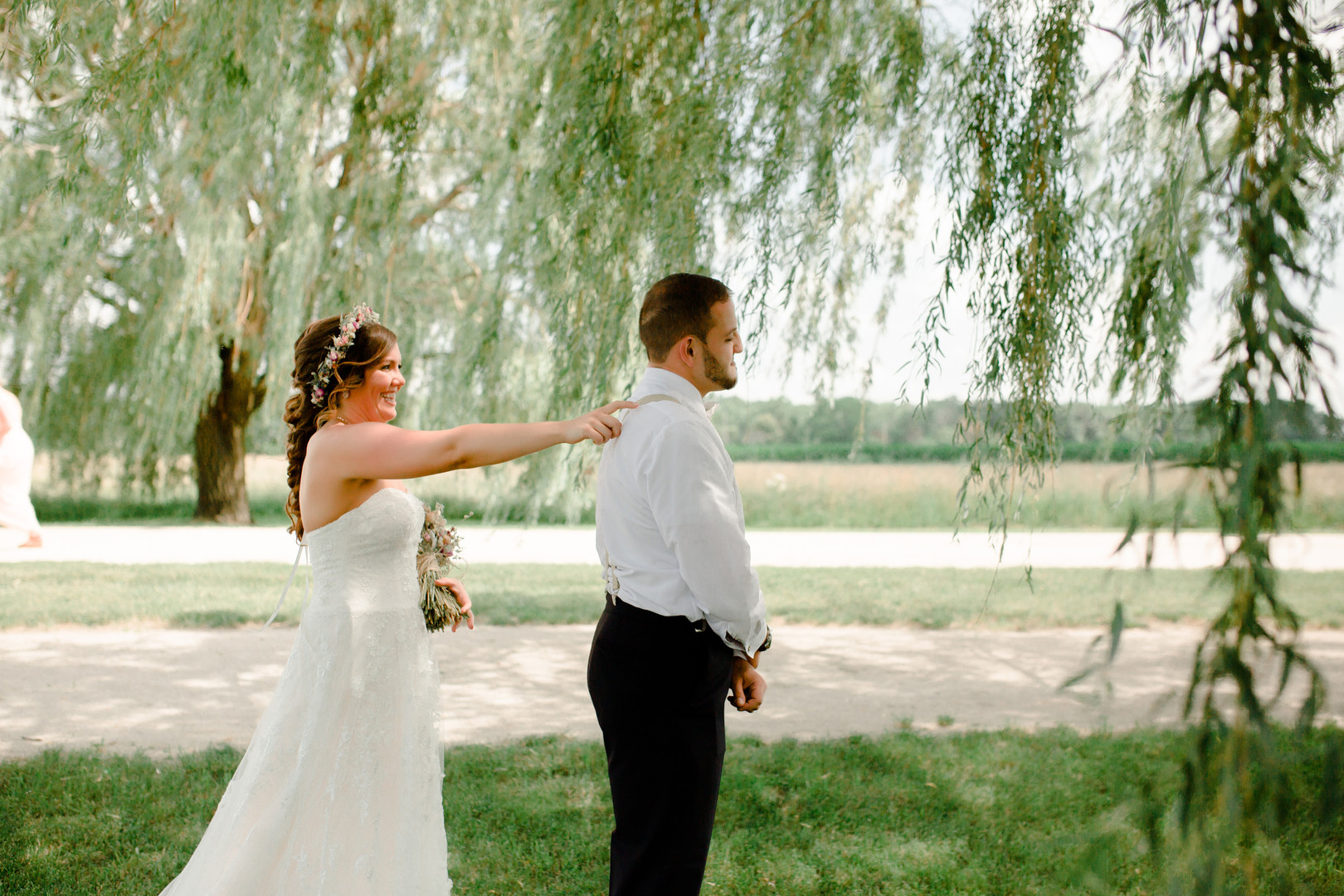 Bride and groom's first look: Rustic country wedding in Minooka, IL captured by Katie Brsan Photography. Visit CHItheeWED.com for more wedding inspiration!
