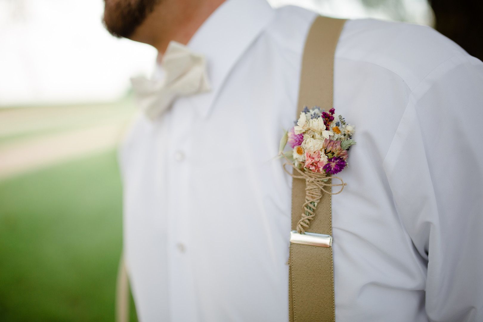 Groom's colorful wedding boutonniere: Rustic country wedding in Minooka, IL captured by Katie Brsan Photography. Visit CHItheeWED.com for more wedding inspiration!