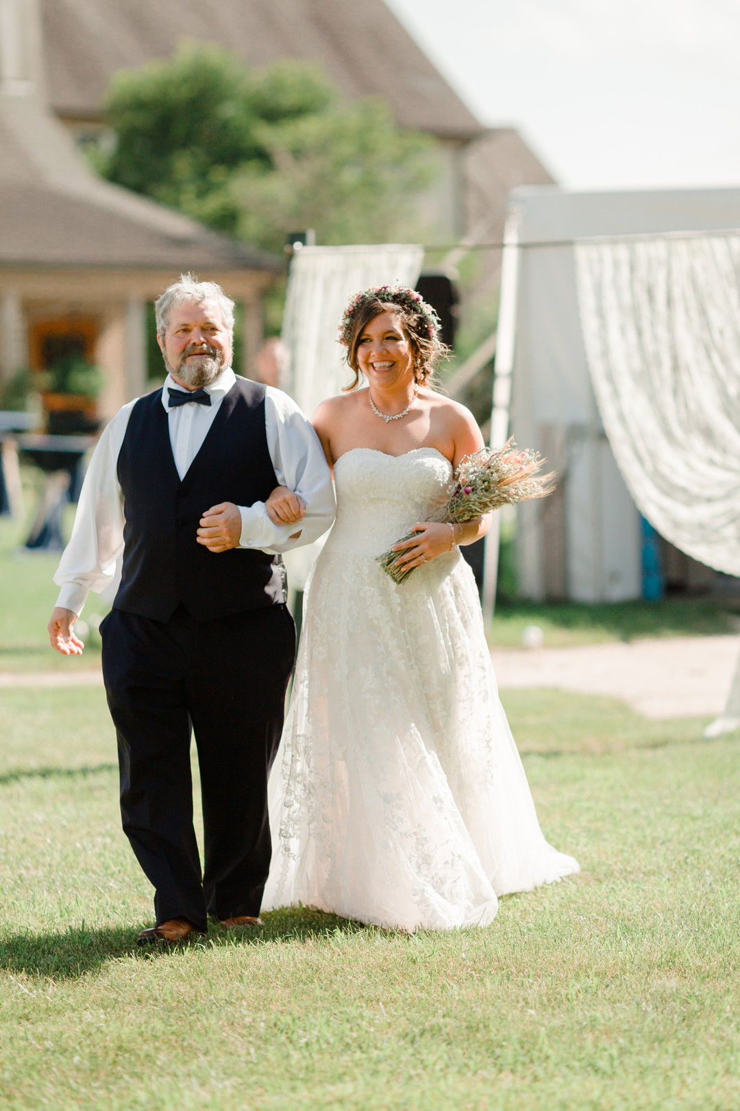 Bride walking down the aisle with father: Rustic country wedding in Minooka, IL captured by Katie Brsan Photography. Visit CHItheeWED.com for more wedding inspiration!