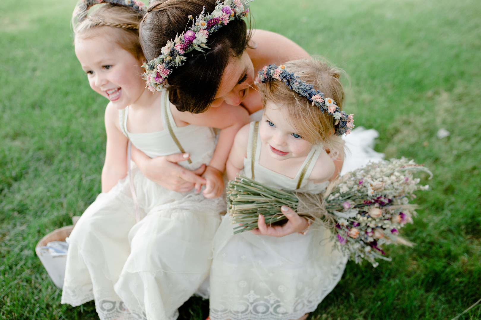 Bride with flower girls: Rustic country wedding in Minooka, IL captured by Katie Brsan Photography. Visit CHItheeWED.com for more wedding inspiration!