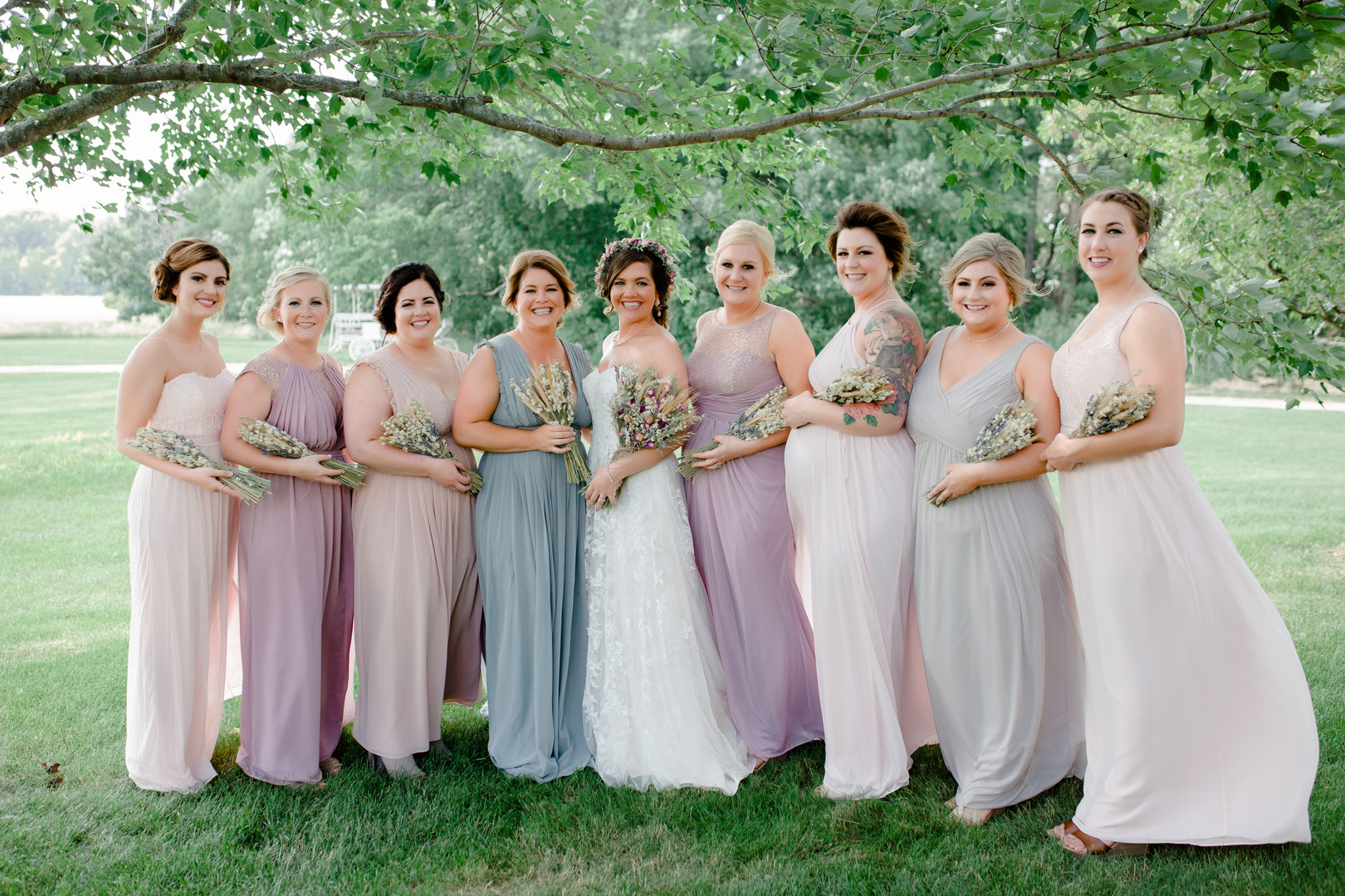 Mismatched pastel bridesmaids dresses: Rustic country wedding in Minooka, IL captured by Katie Brsan Photography. Visit CHItheeWED.com for more wedding inspiration!