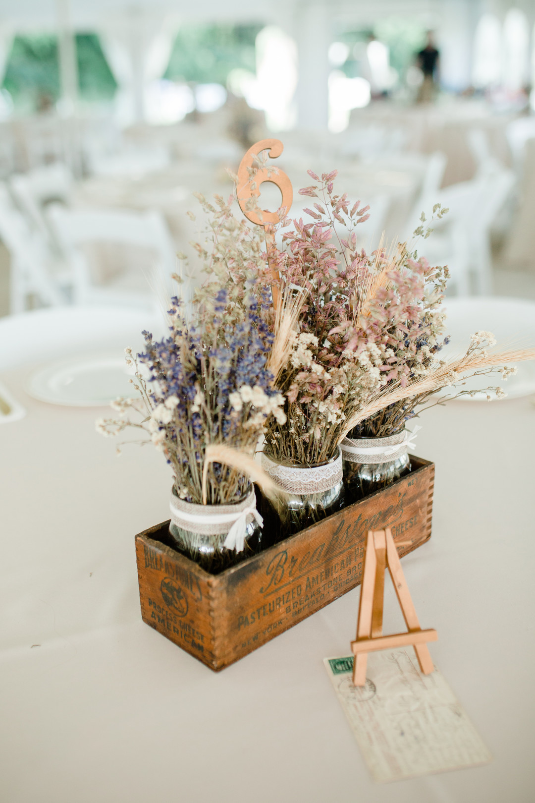 Rustic wedding centerpieces: Rustic country wedding in Minooka, IL captured by Katie Brsan Photography. Visit CHItheeWED.com for more wedding inspiration!