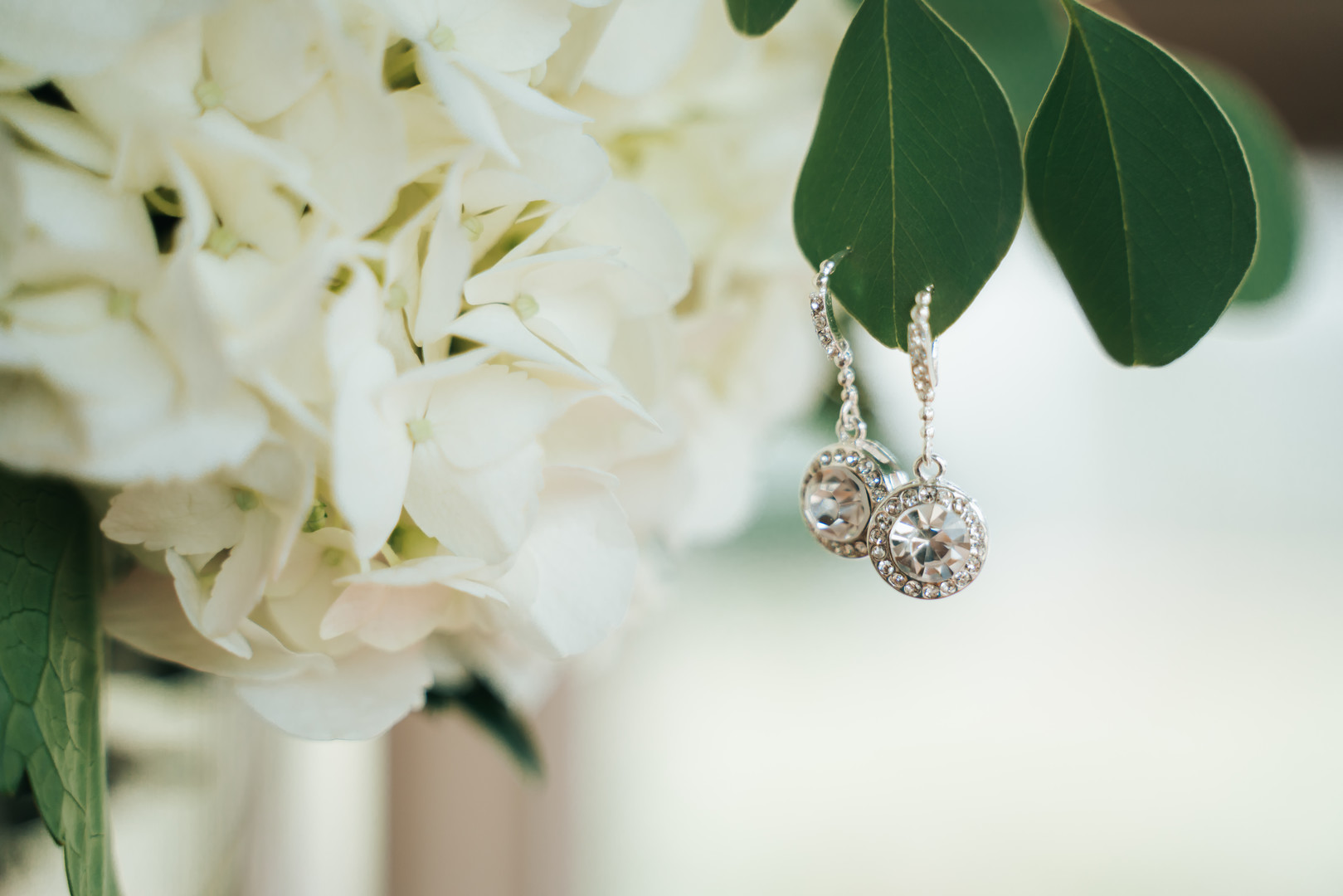 Wedding earrings: Beautiful Illinois wedding at Riverside Receptions captured by Windy City Production. See more wedding ideas at CHItheeWED.com!
