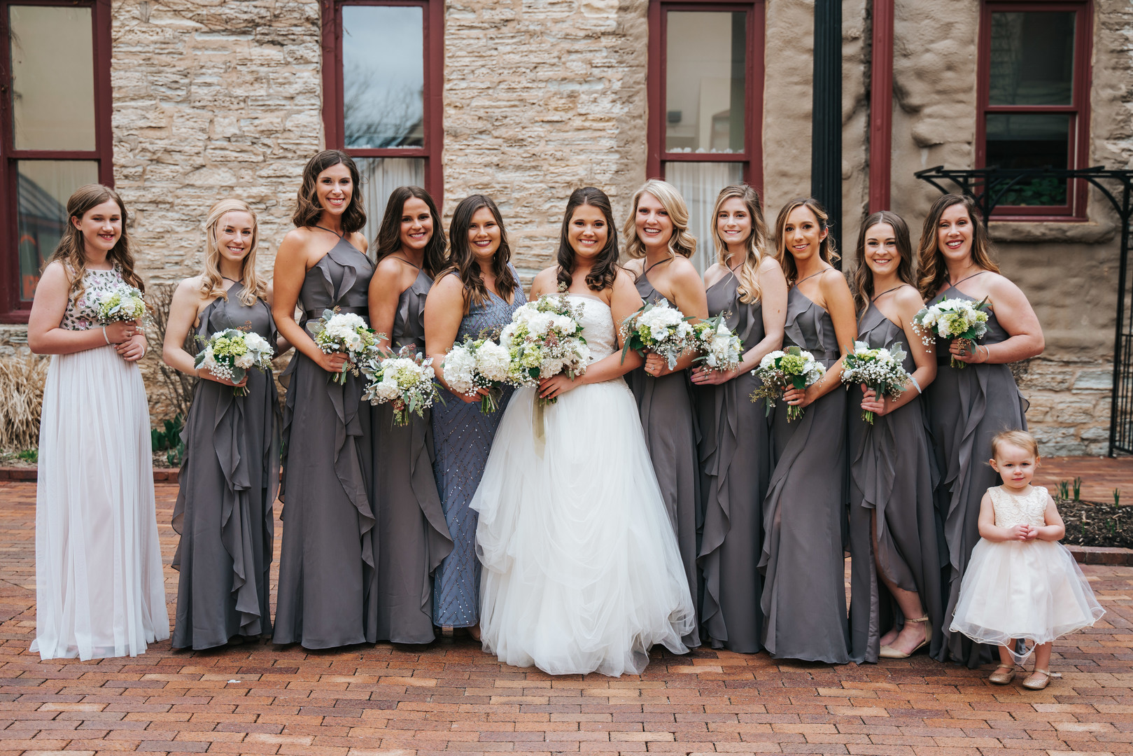 Gray bridesmaids dresses: Beautiful Illinois wedding at Riverside Receptions captured by Windy City Production. See more wedding ideas at CHItheeWED.com!