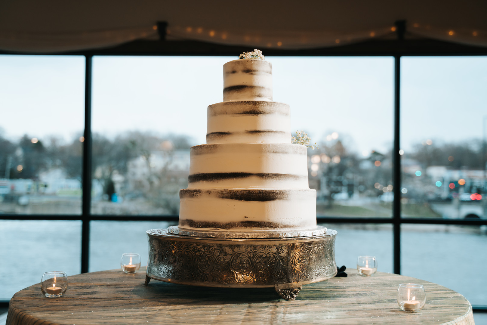 Simple semi-naked wedding cake design: Beautiful Illinois wedding at Riverside Receptions captured by Windy City Production. See more wedding ideas at CHItheeWED.com!