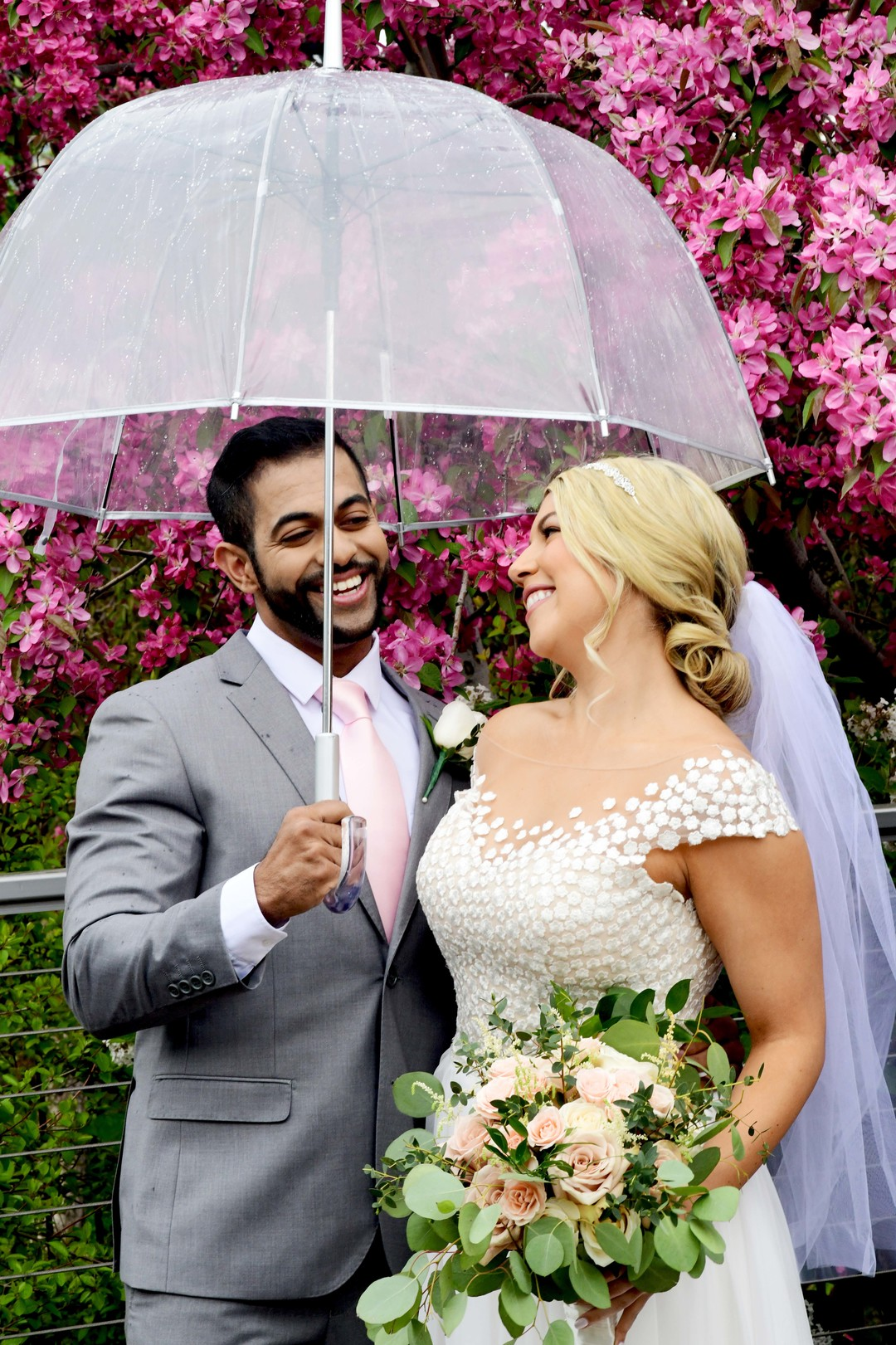 Rainy day wedding photos: Romantic ivory and rose gold wedding inspiration captured by Lori Sapio. See more elegant wedding ideas at CHItheeWED.com!