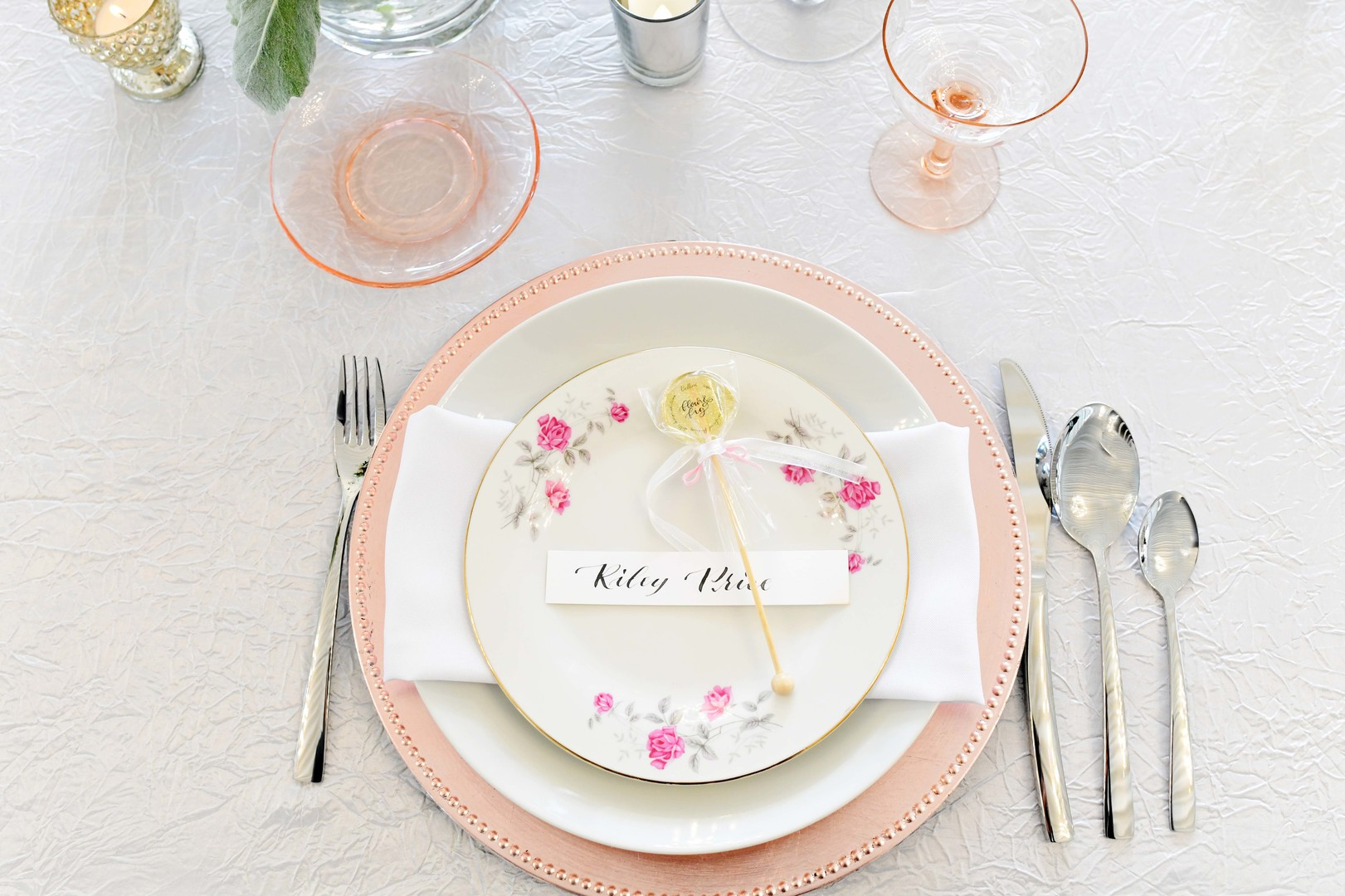 Wedding table setting: Romantic ivory and rose gold wedding inspiration captured by Lori Sapio. See more elegant wedding ideas at CHItheeWED.com!