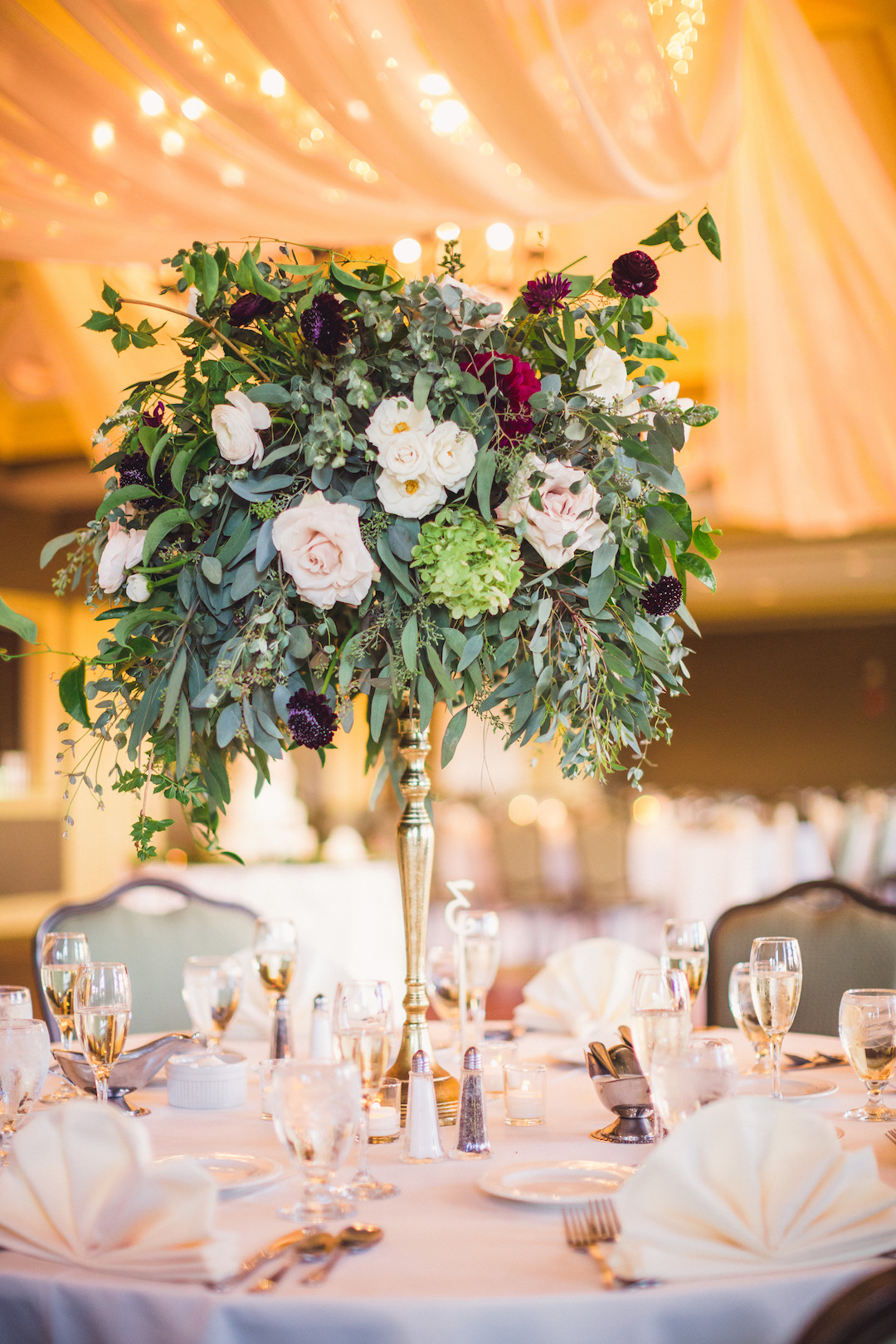 Tall wedding centerpiece: Elegant country club wedding captured by Henington Photography. See more elegant wedding ideas at CHItheeWED.com!