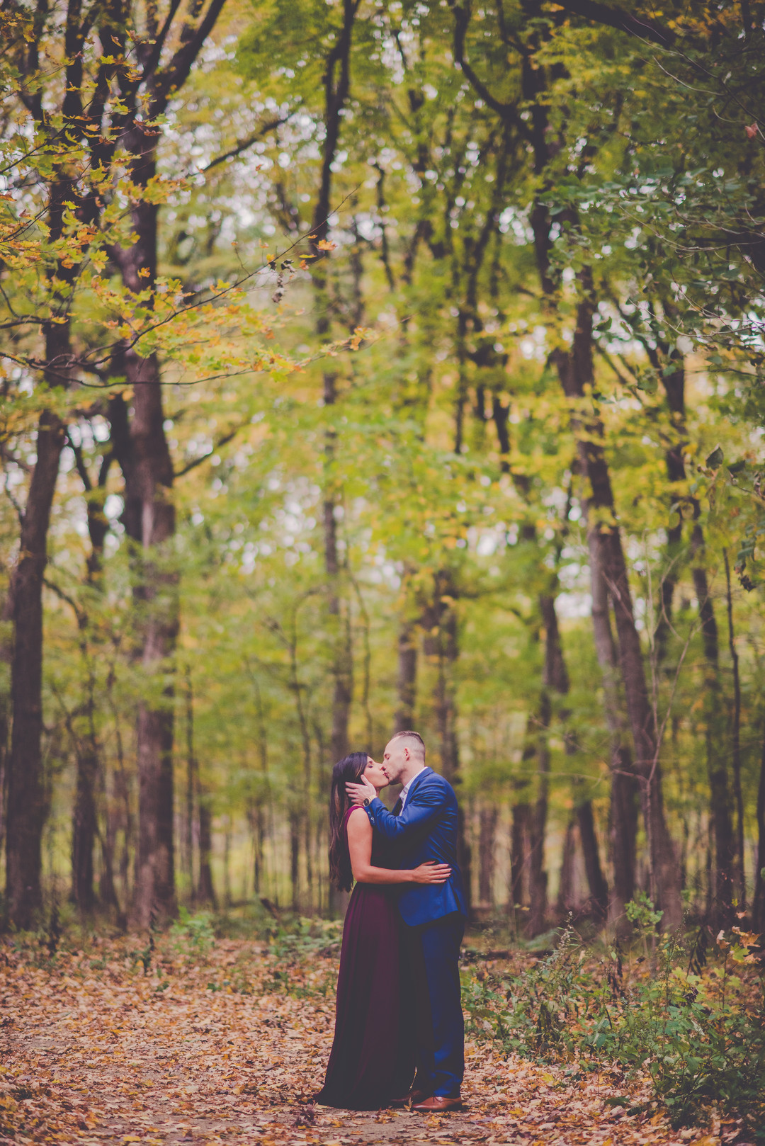 Romantic fall forest engagement session captured by Kara Evans Photographer. See more engagement photo ideas at CHItheeWED.com!