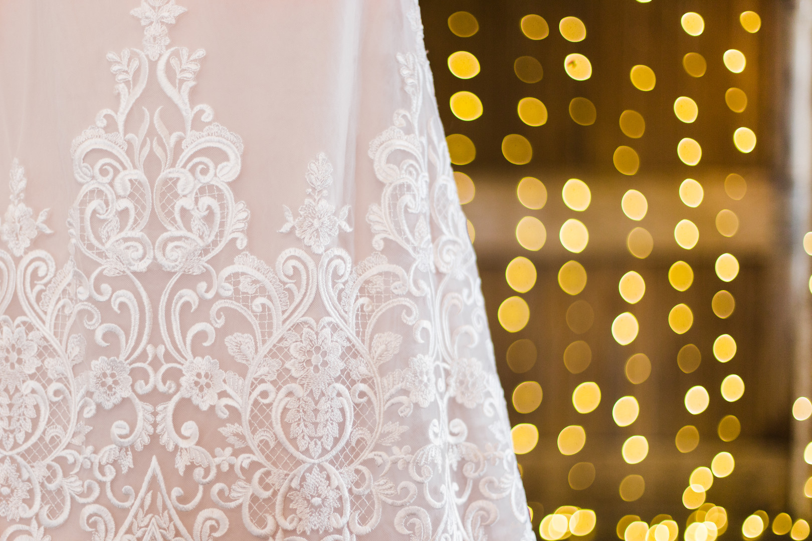Lace wedding dress detail: Rustic barn wedding inspiration captured by Grace Rios Photography. See more fall wedding ideas at CHItheeWED.com!
