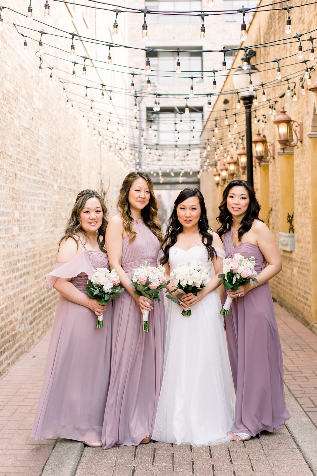 Purple bridesmaids dresses: Spring wedding inspiration captured by Nicole Morisco Photography. Find more spring wedding ideas at CHItheeWED.com!