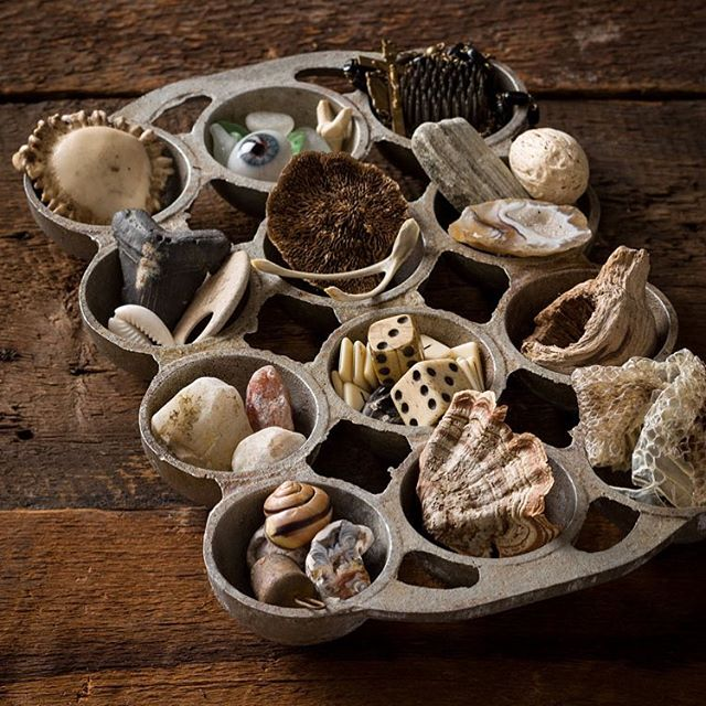 A vintage cast iron tray of adventitious knickknackery; sticks 'n stones, the teeth of land and sea creatures, a mislaid ocular prosthesis, shells & bells, shed snake skin, a fan or two of parched tree fungi, sea glass and other random bits. . DO: remember this could easily become a charcuterie board for an unabashed pup, or a friend three sheets to the wind. DON'T: be selfish and fill it with your own finds ;) (I would). Send the kids out to scavenge this vacation. #win-win. . #foundstyle #eclecticdecor #home #homedecor #interiordesign #interiordesigner #homestyle #vacation #stellarspaces #howyouhome #thethriftedthrone #vintage #antique #heyhomehey #kidsproject #mom #interiordecor #geodes #ricks #nature #naturalstyle #odetotheabode #odetoabode